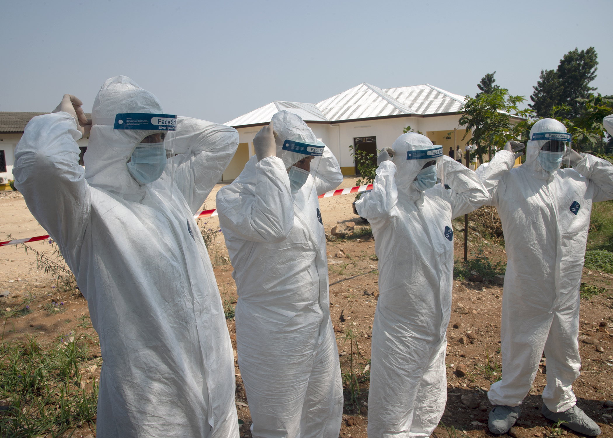 Personnel from Combined Joint Task Force-Horn of Africa (CJTF-HOA) and the Kamenge Military Hospital practice doffing hazardous material suits at the Kamenge Military Hospital, Bujumbura, Burundi, June 20, 2019. The 403rd Civil Affairs Battalion, CJTF-HOA, and military personnel and doctors from the Kamenge Military Hospital conducted an Ebola preparedness subject matter expert exchange as a precautionary measure for personnel near the border of the Democratic Republic of Congo. (U.S. Navy photo by Mass Communication Specialist 1st Class Nick Scott)