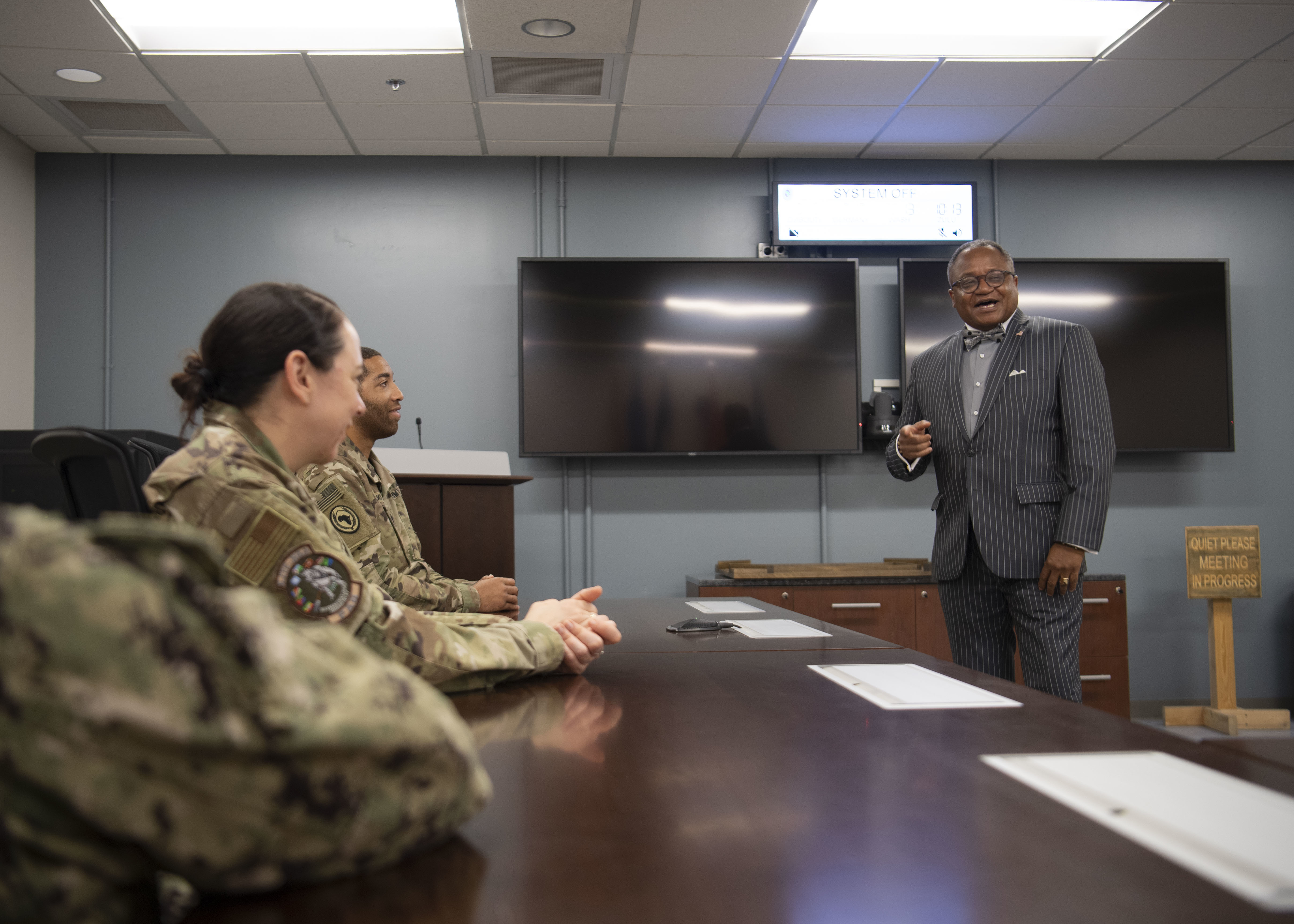 Irvin Hicks Jr., foreign policy advisor (POLAD) for Combined Joint Task Force-Horn of Africa (CJTF-HOA), briefs CJTF-HOA service members at Camp Lemonnier, Djibouti, June 27, 2019. Hicks briefed about his duties as the POLAD and how he contributes to the CJTF-HOA mission. (U.S. Air Force photo by Staff Sgt. J.D. Strong II)