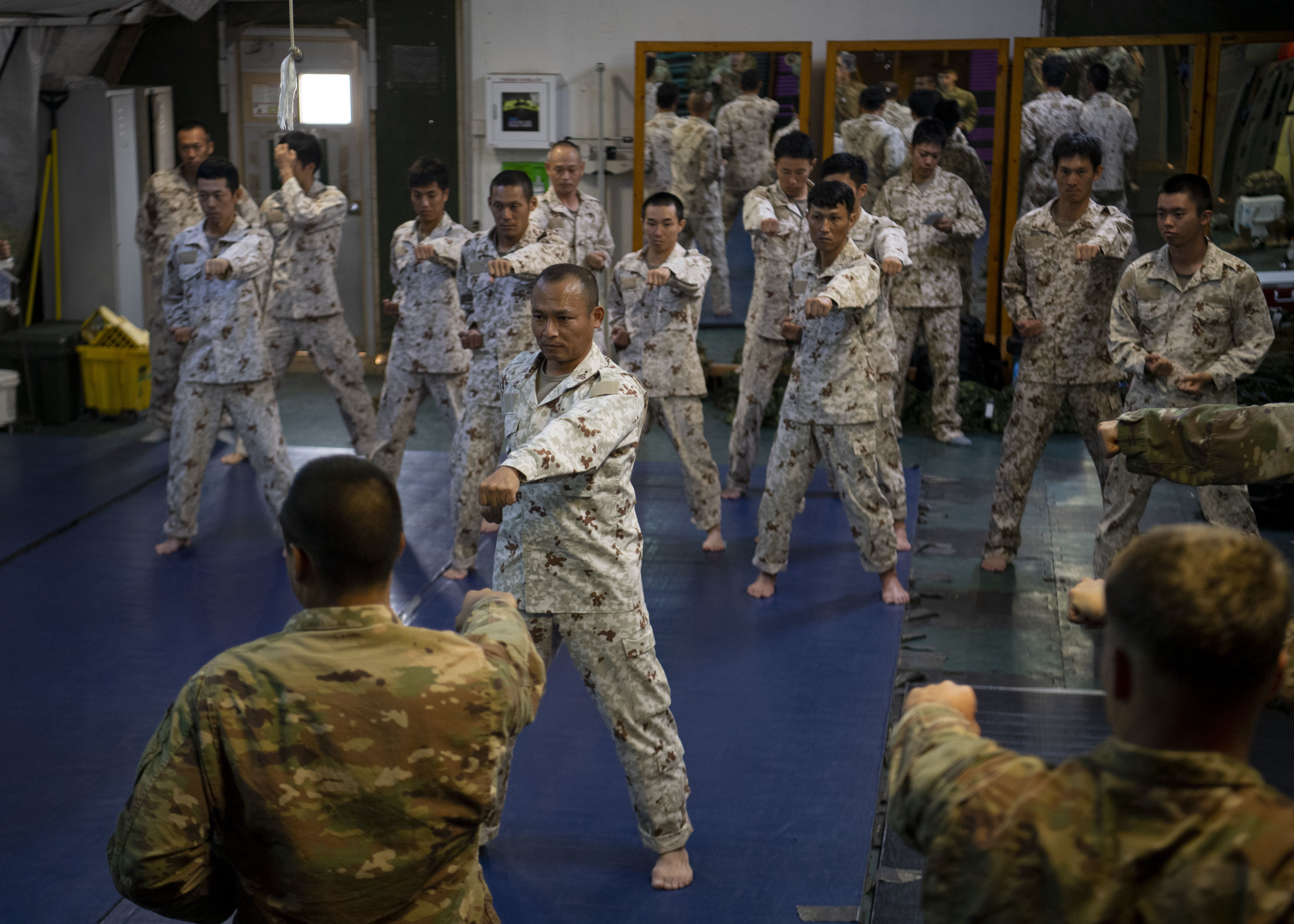 Japanese Ground Self-Defense Force Command Sgt. Maj. Kentaro Nakazato, command sergeant major of the 16th infantry regiment company, leads karate-style striking practice during a combatives exchange with Combined Joint Task Force-Horn of Africa (CJTF-HOA) at Camp Lemonnier, Djibouti, July 1, 2019. The purpose of the joint exchange was to share Japanese combative techniques and forge relationships between CJTF-HOA and the JGSDF. (U.S. Air Force photo by Staff Sgt. J.D. Strong II)