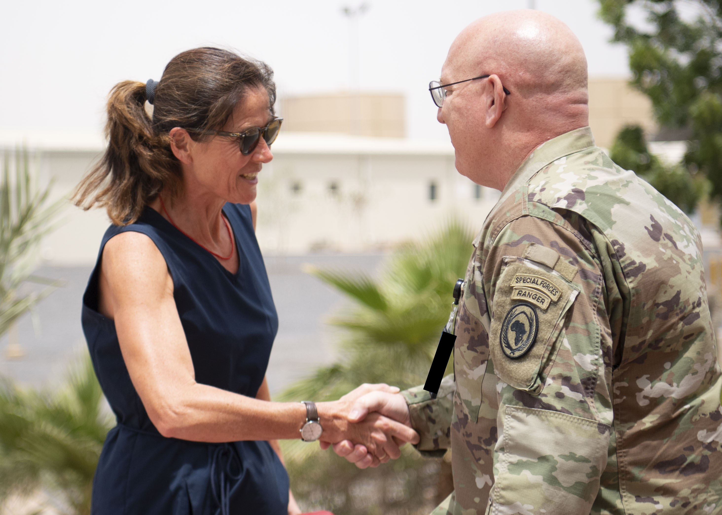 U.S. Army Maj. Gen. Michael D. Turello, commanding general of Combined Joint Task Force-Horn of Africa (CJTF-HOA), right, greets Anke Holstein, Ambassador of Germany to Djibouti, at Camp Lemonnier, Djibouti, July 3, 2019. While visiting Camp Lemonnier, Holstein learned about the CJTF-HOA mission and toured the installation. (U.S. Air Force photo by Staff Sgt. J.D. Strong II)