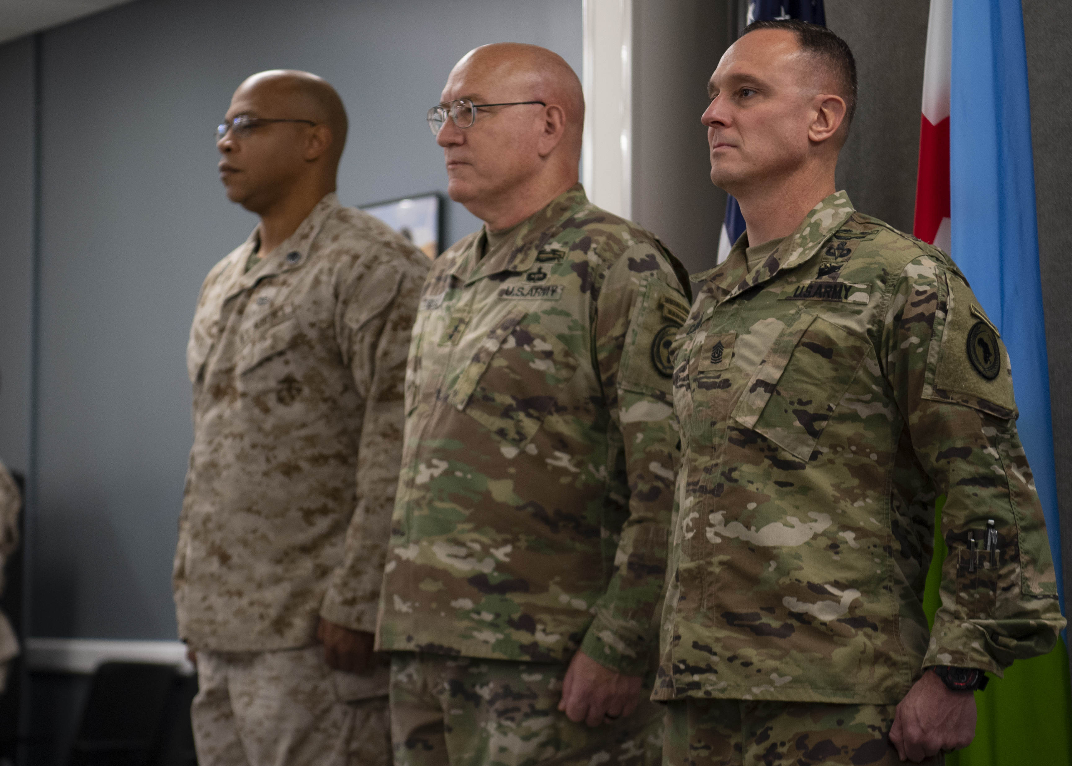 U.S. Army Maj. Gen. Michael Turello, commanding general, Combined Joint Task Force-Horn of Africa (CJTF-HOA), center, presides over the change of responsibility ceremony between incoming CJTF-HOA command senior enlisted leader, U.S. Army Command Sgt. Maj. Shawn Carns, and outgoing CSEL, U.S. Marine Corps Master Gunnery Sgt. Vito Harris, at Camp Lemonnier, Djibouti, July 22, 2019. The CSEL is the principal advisor to the commander and bears the special responsibility of guardianship for all. (U.S. Air Force photo by Staff Sgt. J.D. Strong II)