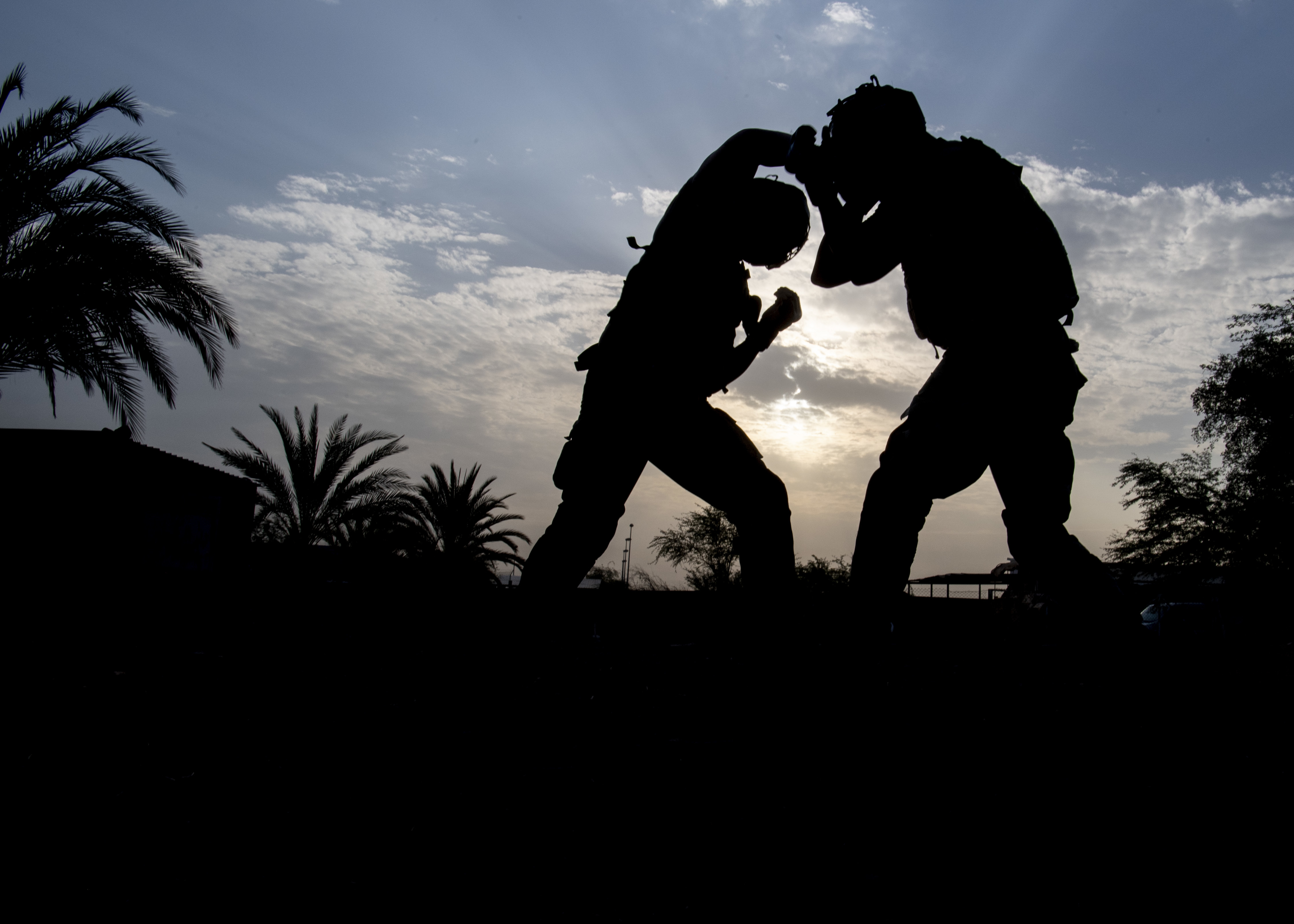 U.S. Army Soldier assigned to Combined Joint Task Force-Horn of Africa (CJTF-HOA) and French Marine assigned to the 5th Overseas Intermarines Regiment (RIAOM) spar during a combatives exchange at Djibouti Air Base, Djibouti, Sept. 2, 2019. The purpose of the joint training was to share French Marine and U.S. Army combative techniques and further the relationship between the two forces. (U.S. Air Force photo by Staff Sgt. J.D. Strong II)