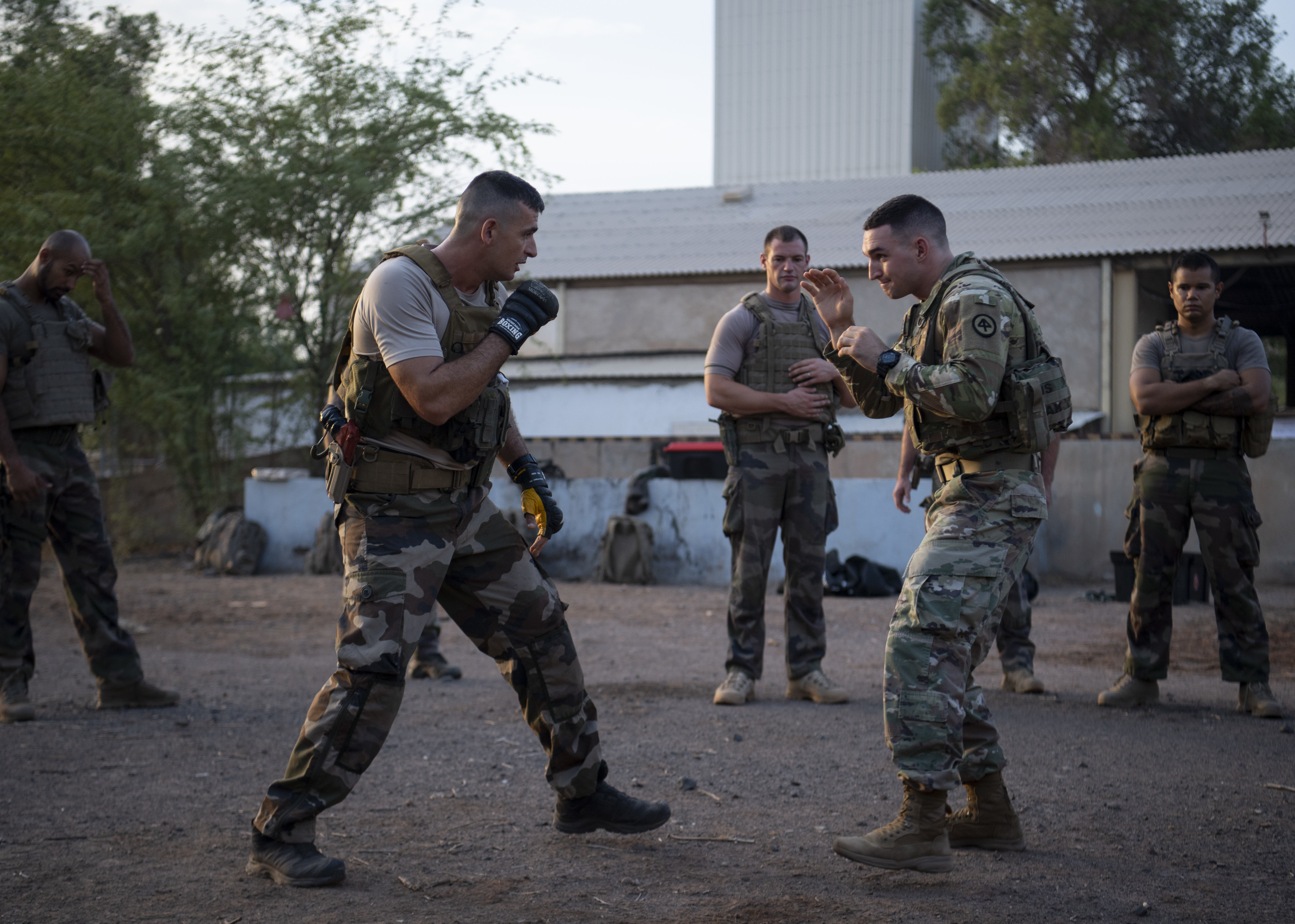 U.S. Army 1st Lt. Brian Caulfield security forces liason officer assigned to Combined Joint Task Force-Horn of Africa (CJTF-HOA) and SCH Ferrer Dimitri combatives instructor assigned to the 5th Overseas Intermarines Regiment spar during a combatives exchange at Djibouti Air Base, Djibouti, Sept. 2, 2019. The purpose of the joint training was to share French Marine and U.S. Army combative techniques and further the relationship between the two forces. (U.S. Air Force photo by Staff Sgt. J.D. Strong II)