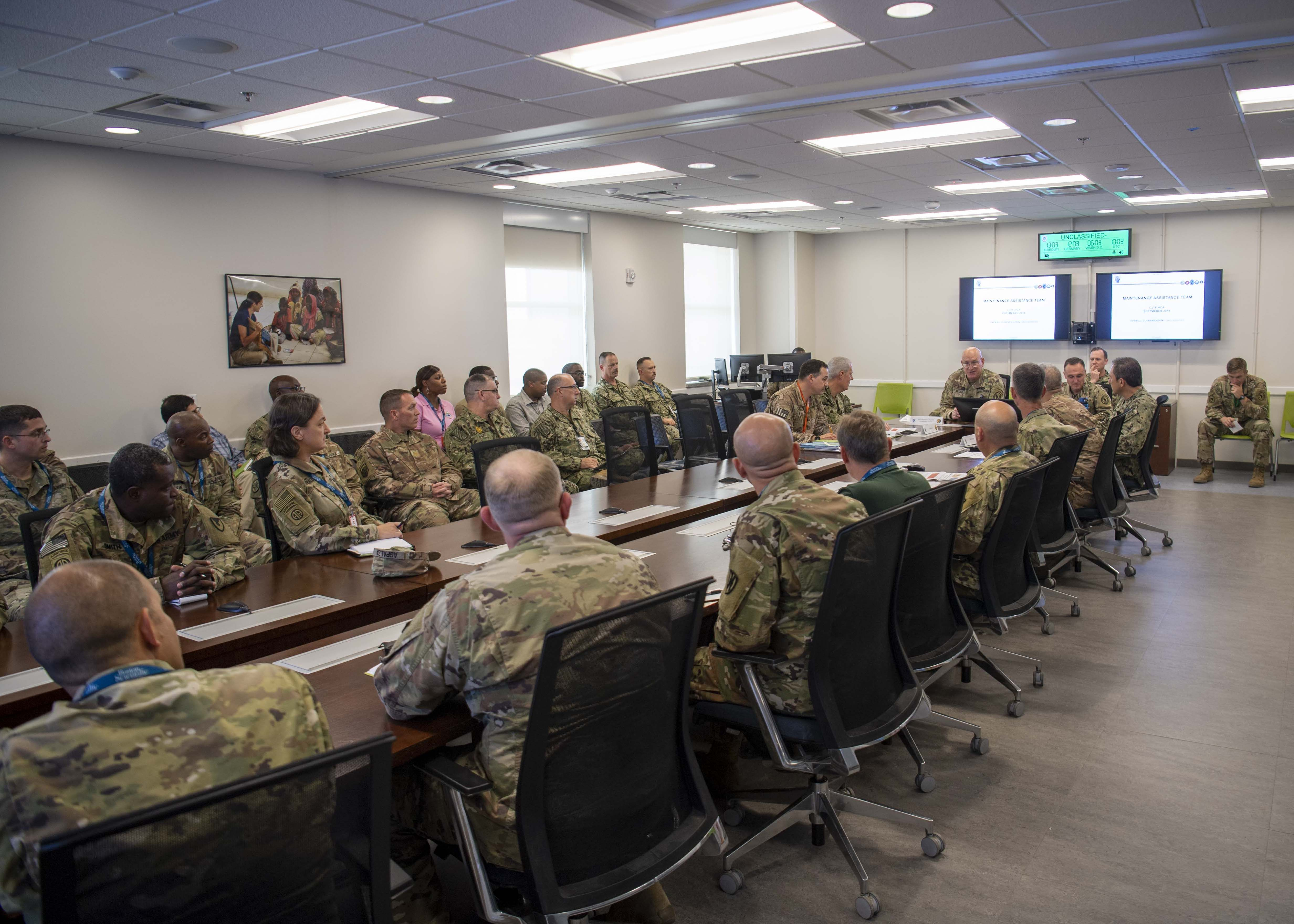 U.S. Army Maj. Gen. Michael Turello, commanding general, Combined Joint Task Force-Horn of Africa (CJTF-HOA), meets with CJTF-HOA leadership and a maintenance assistance and inspection team (MAIT) at Camp Lemonnier, Djibouti, Sept. 16, 2019. MAITs are focused on finding solutions to logistics and maintenance challenges. (U.S. Air Force photo by Staff Sgt. J.D. Strong II)