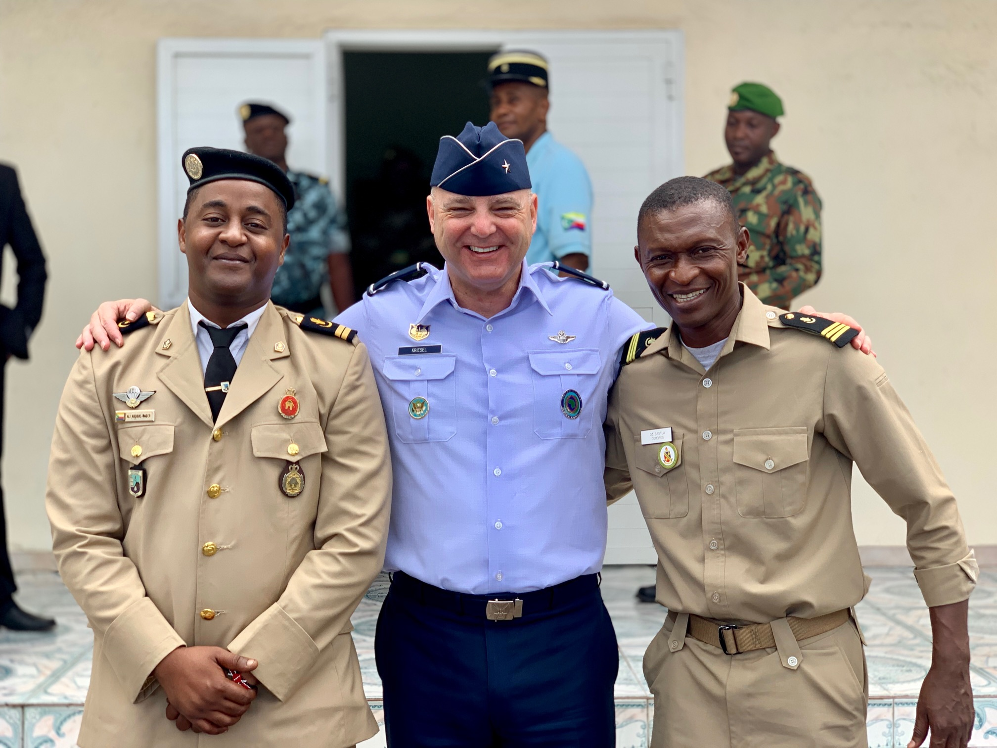 U.S. Air Force Brig. Gen. James R. Kriesel, deputy commanding general of Combined Joint Task Force-Horn of Africa (CJTF-HOA), poses for a photo with Comoros Lt. Ali Abdoul-Kader, Comoros foreign liaison officer (FLO) to CJTF-HOA, left, and Comoros Capt. Bastua, a previous Comoros FLO to CJTF-HOA, at the Enfag language school in Comoros, Sept. 9, 2019. Kriesel visited Comoros to conduct country familiarization and key leader engagements. (Courtesy photo by U.S. Army Maj. Judith Griep)