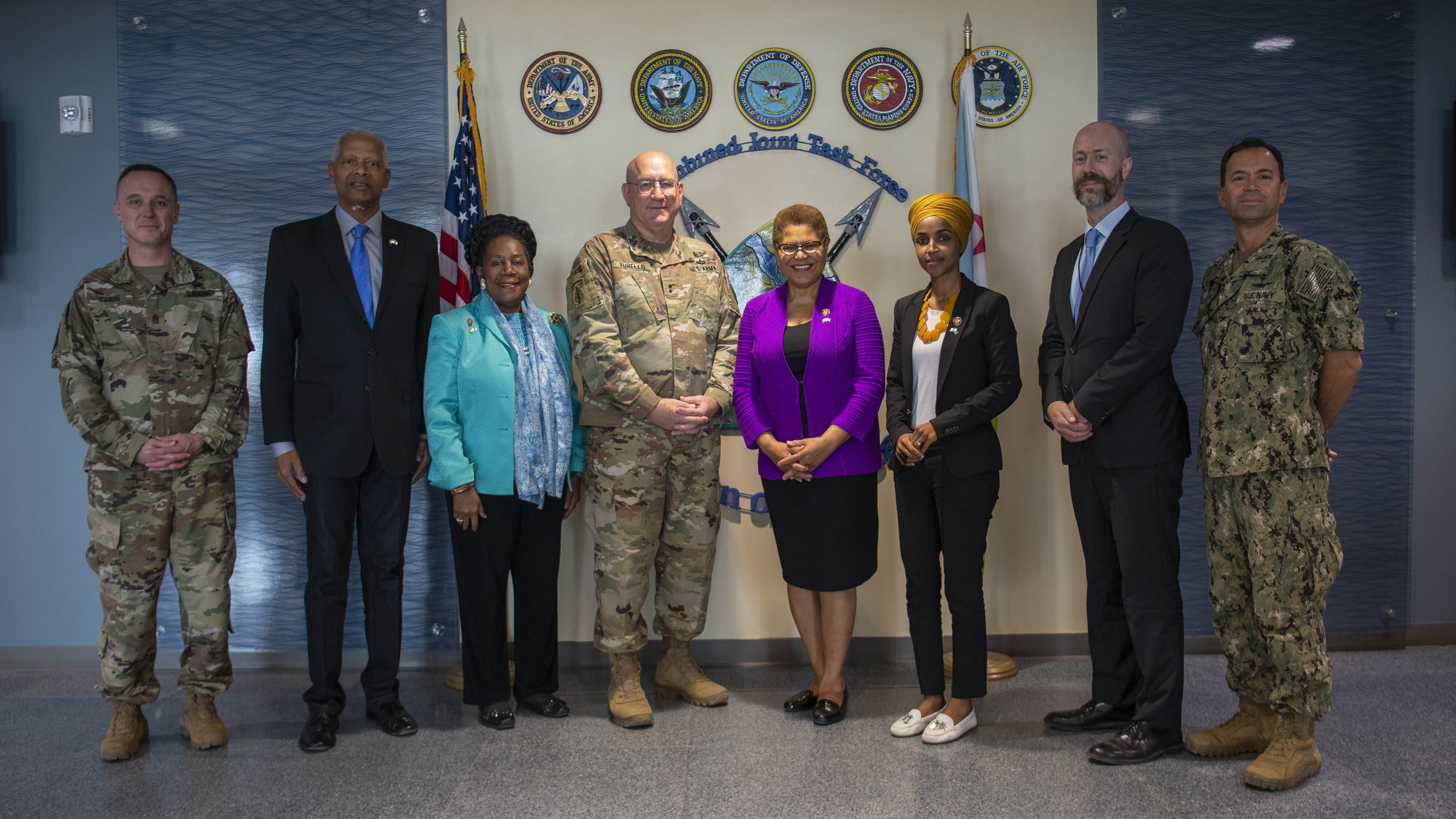 U.S. Army Maj. Gen. Michael Turello, commanding general, Combined Joint Task Force-Horn of Africa (CJTF-HOA), center-left, poses with Rep. Karen Bass (D-Calif.) center-right, for a group photo at Camp Lemonnier, Djibouti, Oct. 1, 2019. Bass visited Djibouti to promote U.S. Government and host nation partnerships in the region. (U.S. Air Force photo by Staff Sgt. J.D. Strong II)