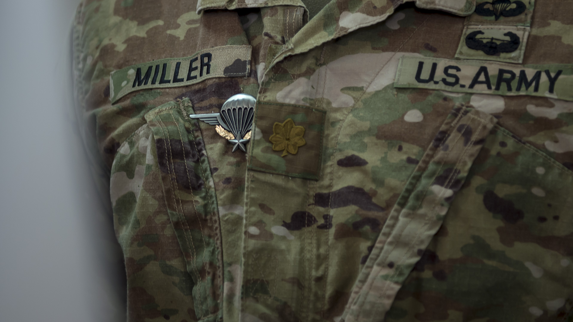 U.S. Army Maj. Marcus Miller, special technical operations chief, assigned to Combined Joint Task Force-Horn of Africa stands at attention after being presented his French Jump Wings at a ceremony on the French Forces Djibouti Base, Sept. 29, 2019. Miller was one of thirteen Americans who participated in the jump, which also included French, Italian, and Djiboutian servicemembers. (U.S. Air Force Photo by Senior Airman Codie Trimble)