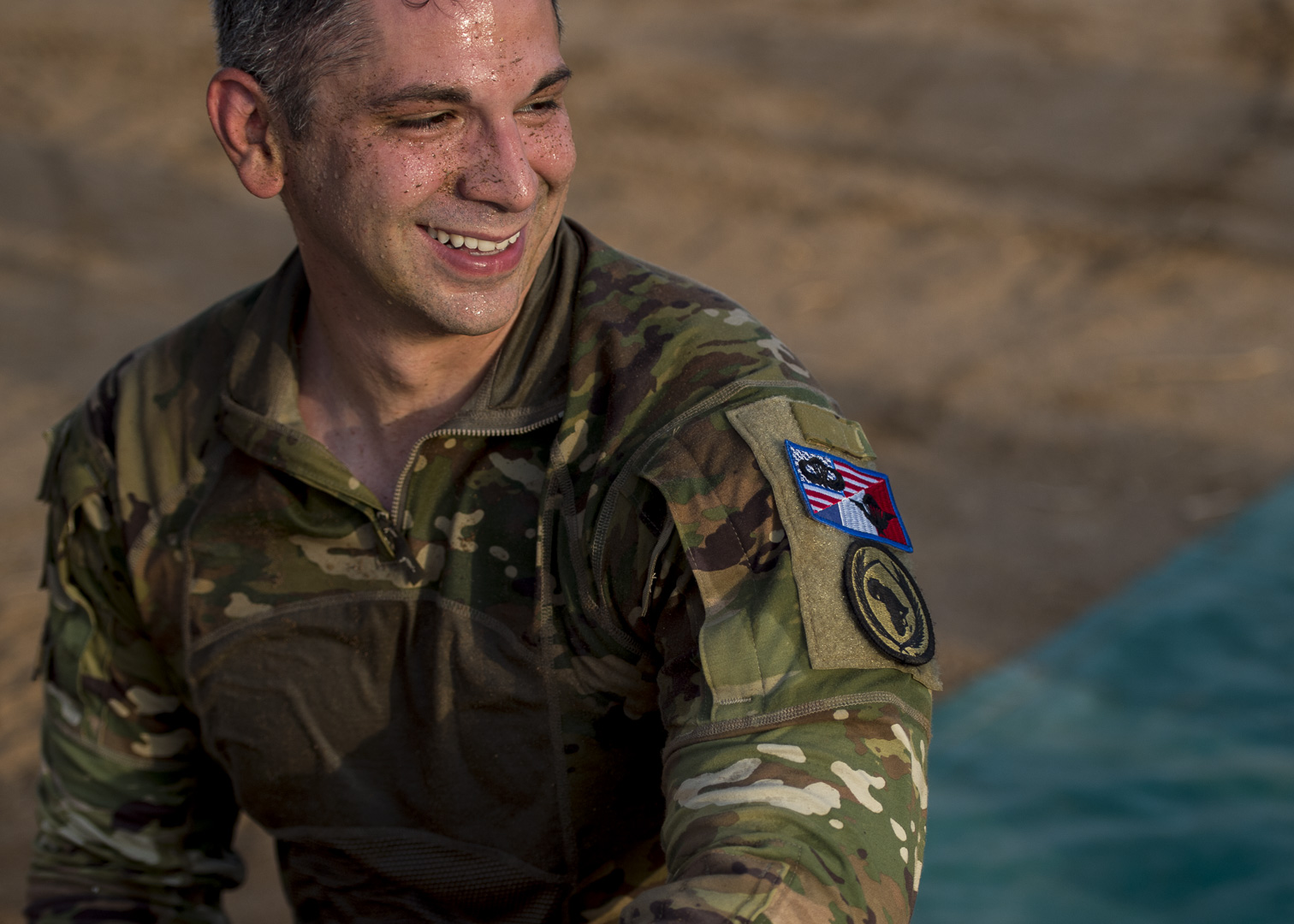 U.S. Army Maj. Marcus Miller, special technical operations chief, assigned to Combined Joint Task Force-Horn of Africa re-packs his parachute after a static line jump with American and coalition partners, outside Djibouti City, Djibouti, Sept. 29, 2019. American service members and coalition partners jumped together to celebrate the Feast Day of Archangel Michael, the patron saint of paratroopers. (U.S. Air Force Photo by Senior Airman Codie Trimble)