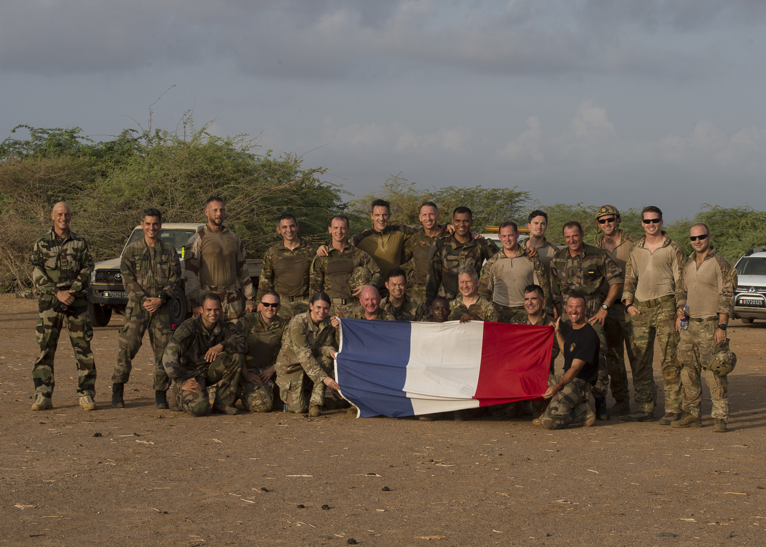 U.S. and French servicemembers pose for a group photo after a static line jump outside Djibouti City, Djibouti, Sept. 29, 2019.  American service members and coalition partners jumped together to celebrate the Feast Day of Archangel Michael, the patron saint of paratroopers. (U.S. Air Force Photo by Senior Airman Codie Trimble) (U.S. Air Force Photo by Senior Airman Codie Trimble)(U.S. Air Force Photo by Senior Airman Codie Trimble)