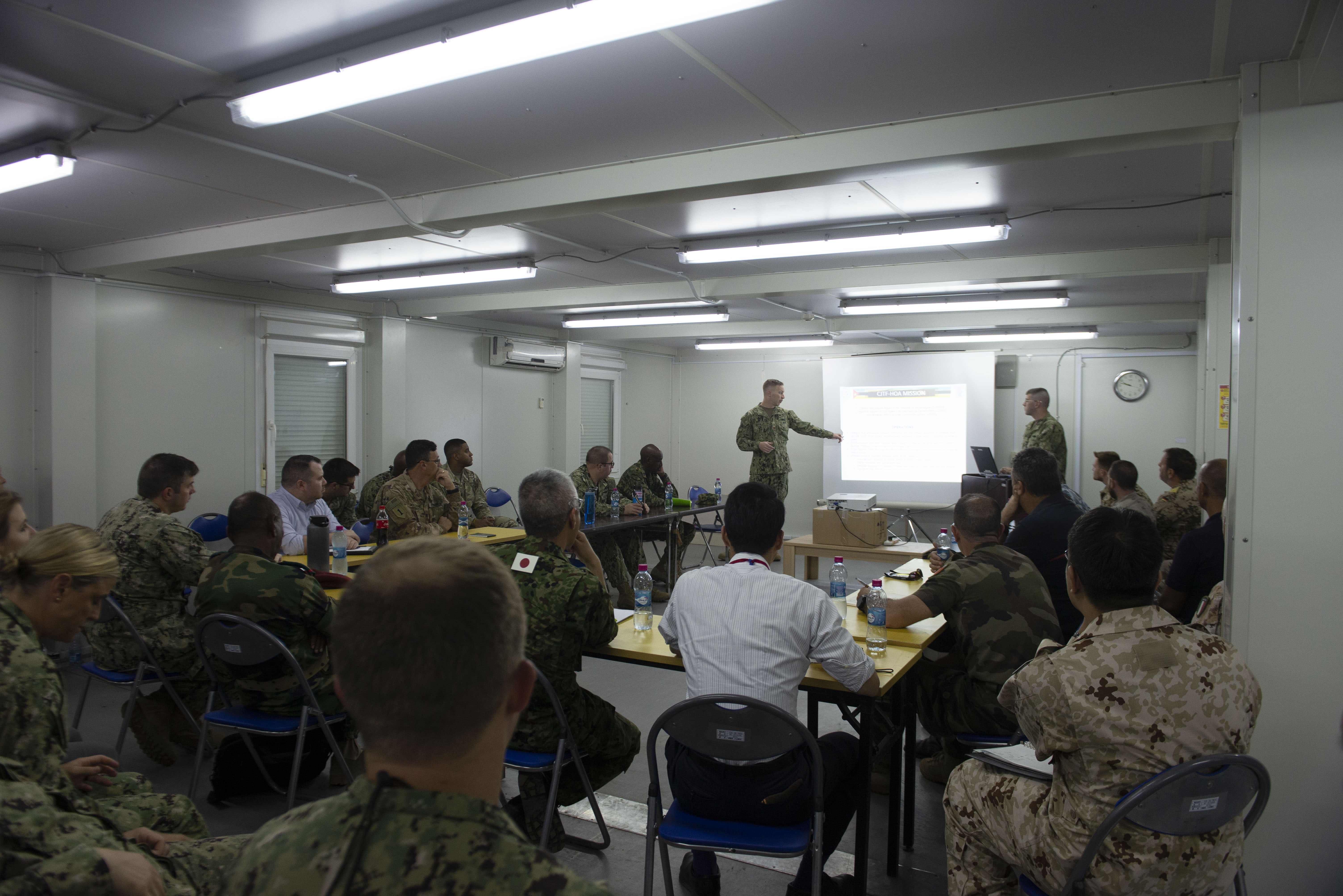 U.S. Navy Lt. Cmdr. Thomas Koehler, contingency branch chief assigned to Combined JointTask Force-Horn of Africa (CJTF-HOA), briefs U.S. noncombatant evacuation operation (NEO) rules of engagement during a Japanese-led NEO exercise in Djibouti, Africa, Oct. 1, 2019. A NEO is the military assisted departure of civilian noncombatants and nonessential military personnel. (U.S. Air Force photo by Senior Airman Gabrielle Spalding)