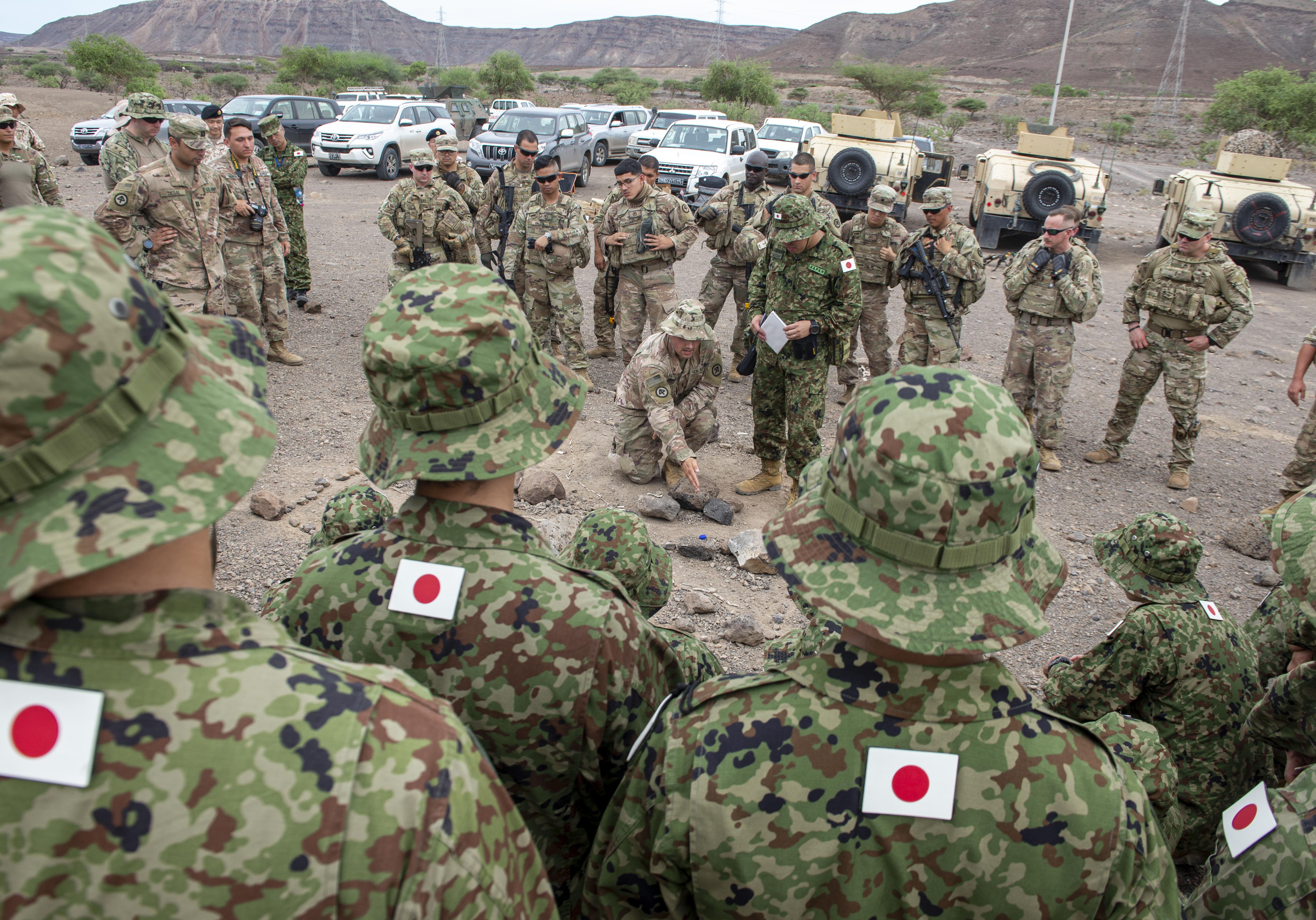 U.S. Army 1st Lt. Nicholas Sereday, executive officer for Charlie Company 2-113th Infantry assigned to Combined Joint Task Force-Horn of Africa (CJTF-HOA), gives a concept of operations (CONOP) brief to Japanese and U.S. military forces during a bilateral field training exercise (FTX) in Djibouti, Africa, Oct. 2, 2019. The FTX was part of a Japanese-led noncombatant evacuation operation (NEO) exercise, which also included African coalition partners. (U.S. Air Force photo by Senior Airman Gabrielle Spalding)