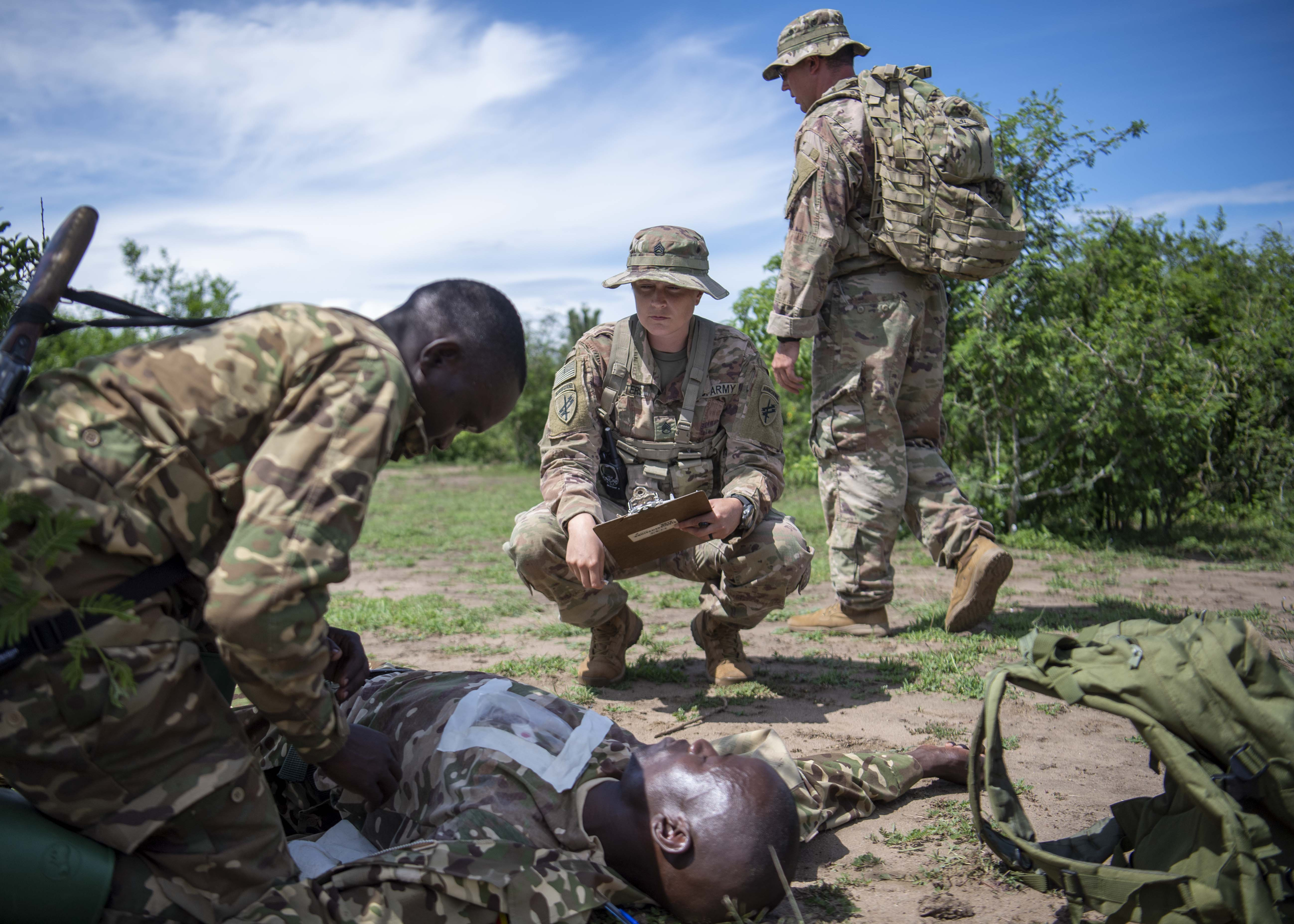 U.S. Army Staff Sgt. Elisha Waiters, instructor, 403rd Civil Affairs Battalion assigned to Combined Joint Task Force-Horn of Africa writes a team evaluation during a Counter Illicit Trafficking Junior Leadership Course examination at Queen Elizabeth Park, Uganda, Oct. 10, 2019. Waiters was one of six instructors who taught Uganda Wildlife Authority (UWA) Rangers how to conduct land navigation, conduct small unit tactics, respond to wildlife crimes, ethics and medically treat a casualty. (U.S. Air Force photo by Staff Sgt. J.D. Strong II)