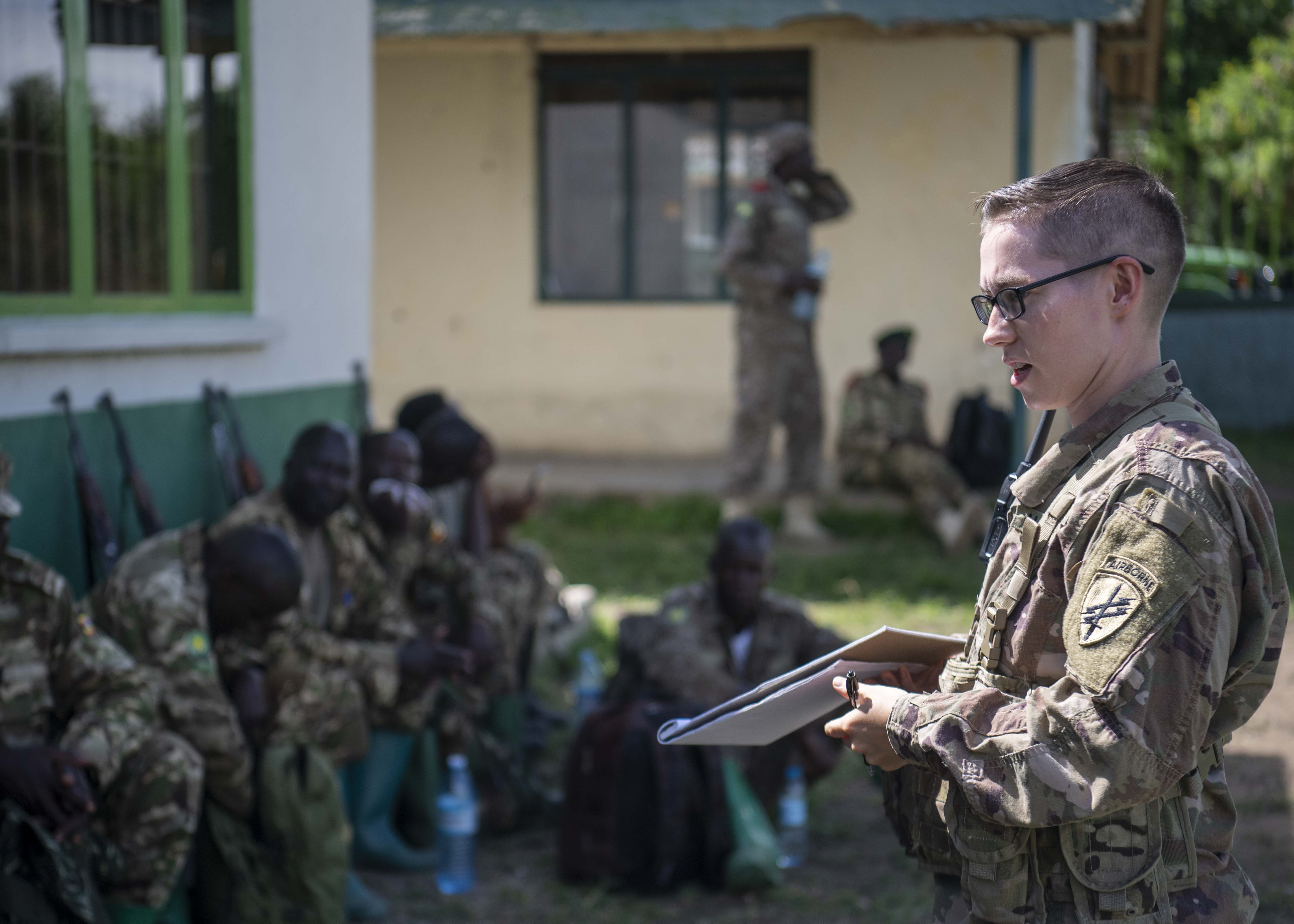 U.S. Army Sgt. Kyri Jones, instructor, 403rd Civil Affairs Battalion assigned to Combined Joint Task Force-Horn of Africa writes a team evaluation during a Counter Illicit Trafficking Junior Leadership Course examination at Queen Elizabeth Park, Uganda, Oct. 10, 2019. Jones was one of six instructors who taught Uganda Wildlife Authority (UWA) Rangers how to conduct land navigation, conduct small unit tactics, respond to wildlife crimes, ethics and medically treat a casualty. (U.S. Air Force photo by Staff Sgt. J.D. Strong II)