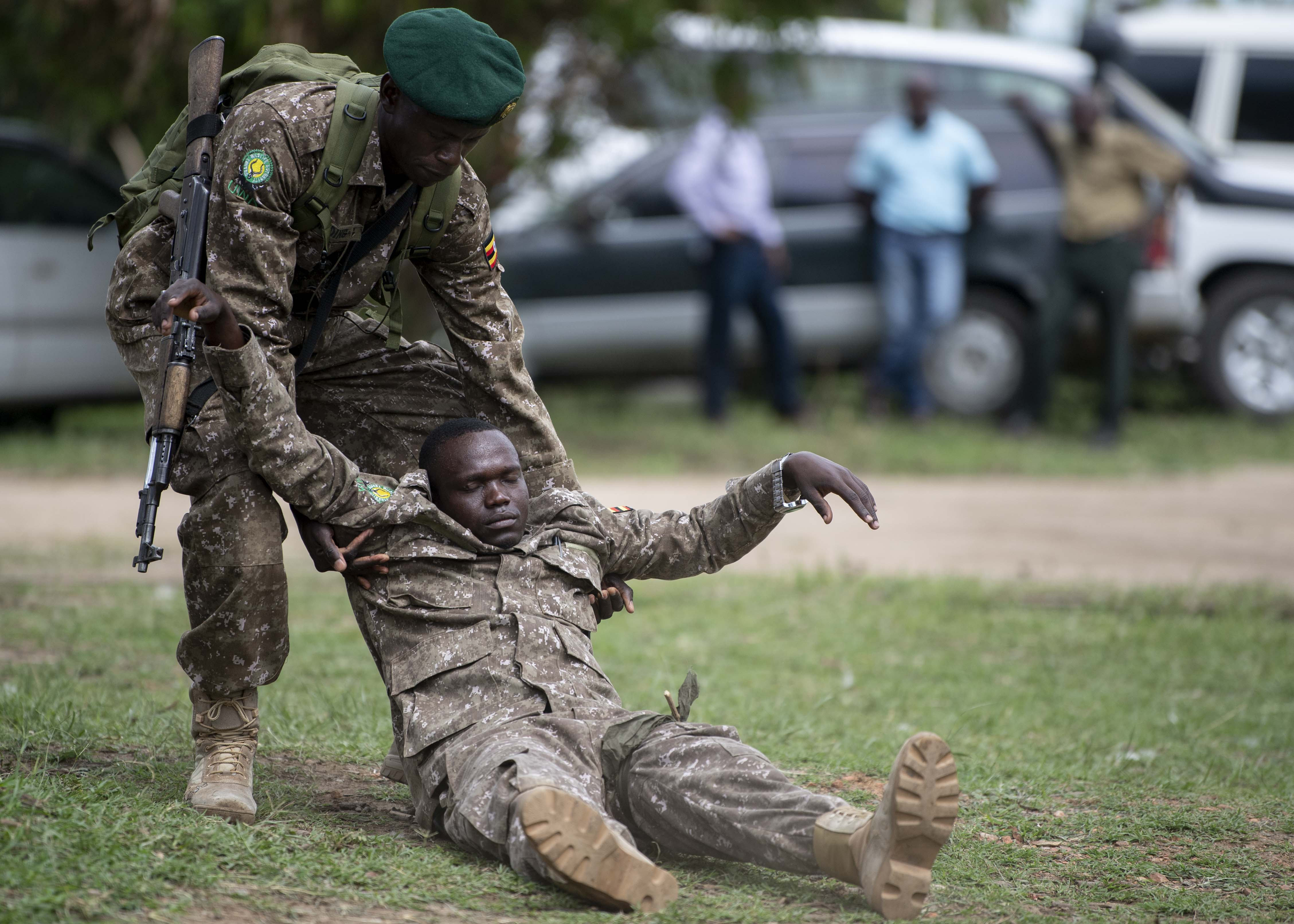 A Uganda Wildlife Authority (UWA) Ranger drags his fellow Ranger from mock danger before performing casualty care during a Counter Illicit Trafficking Junior Leadership Course graduation demonstration at Queen Elizabeth Park, Uganda, Oct. 10, 2019. Twenty-five UWA Rangers graduated the course. (U.S. Air Force photo by Staff Sgt. J.D. Strong II)