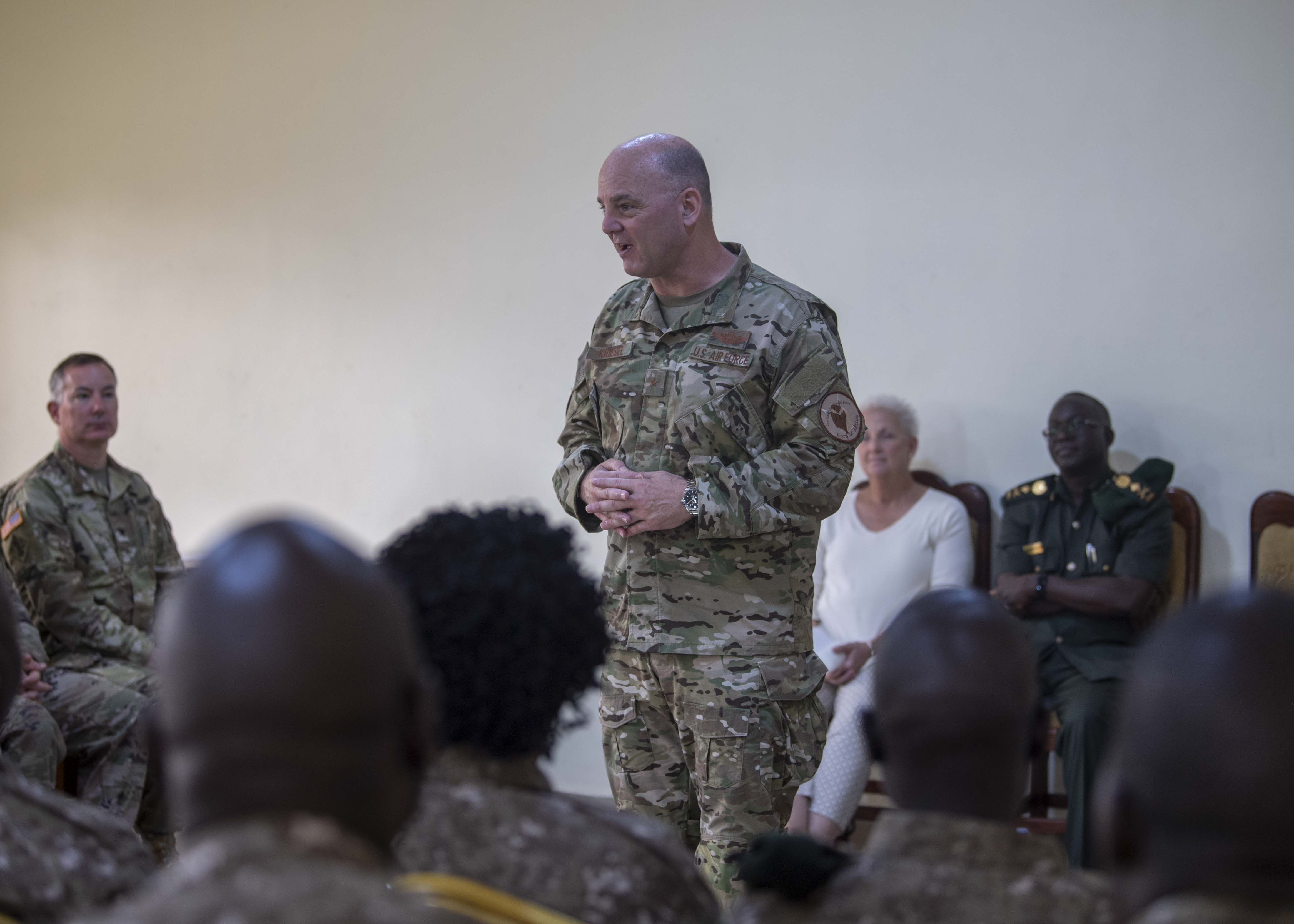 U.S. Air Force Brig. Gen. James R. Kriesel, deputy commanding general of Combined Joint Task Force-Horn of Africa (CJTF-HOA), provides remarks to the Uganda Wildlife Authority (UWA) Ranger graduates during a Counter Illicit Trafficking Junior Leadership Course graduation at Queen Elizabeth Park, Uganda, Oct. 10, 2019. Twenty-five UWA Rangers graduated the course. (U.S. Air Force photo by Staff Sgt. J.D. Strong II)