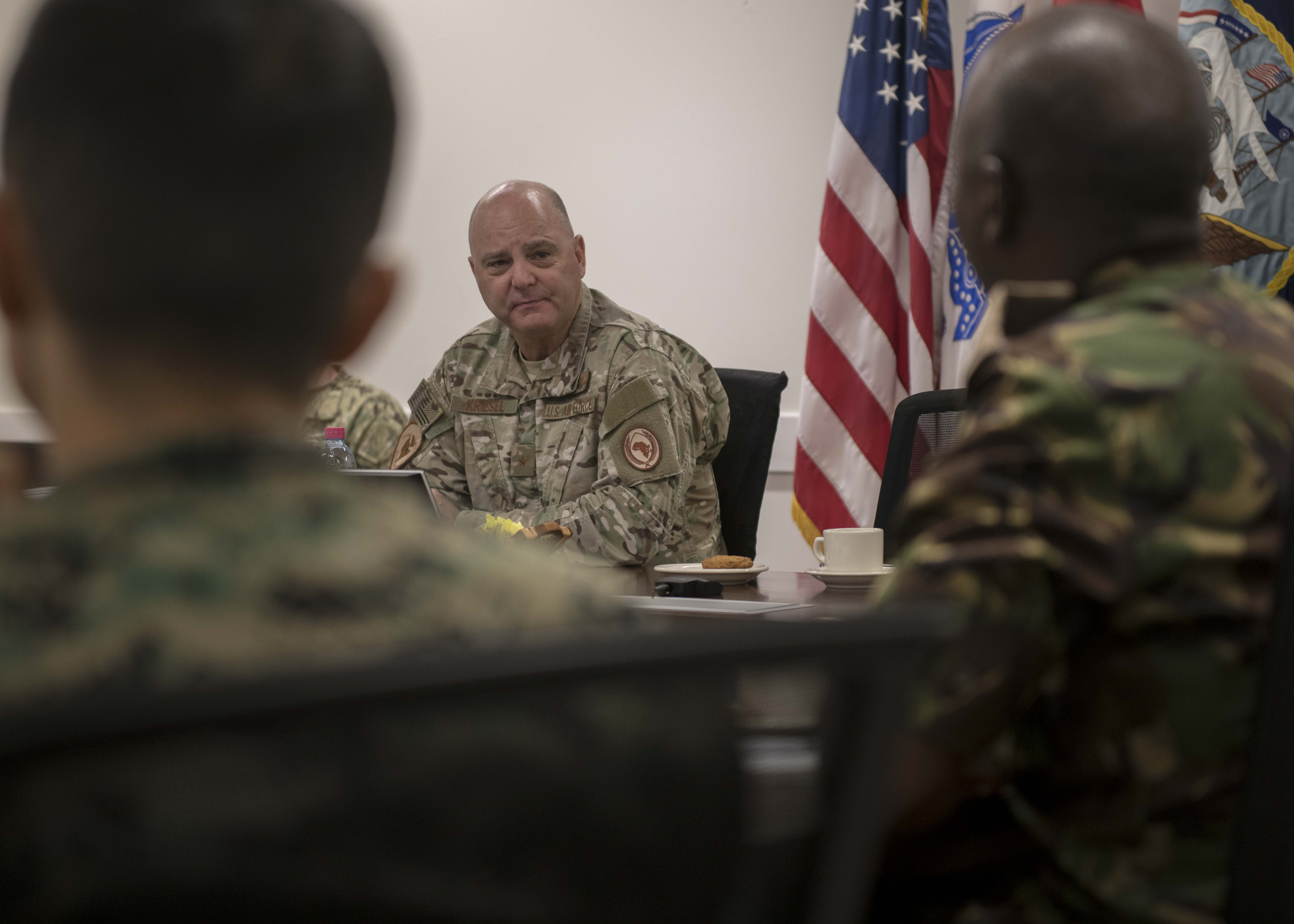 U.S. Air Force Brig. Gen. James R. Kriesel, deputy commanding general of Combined Joint Task Force - Horn of Africa (CJTF-HOA), meets with coalition foreign liaison officers (FLOs) assigned to CJTF-HOA. The FLOs act as first line communicators between CJTF-HOA and their country. (U.S. Air Force Photo by Senior Airman Codie Trimble)