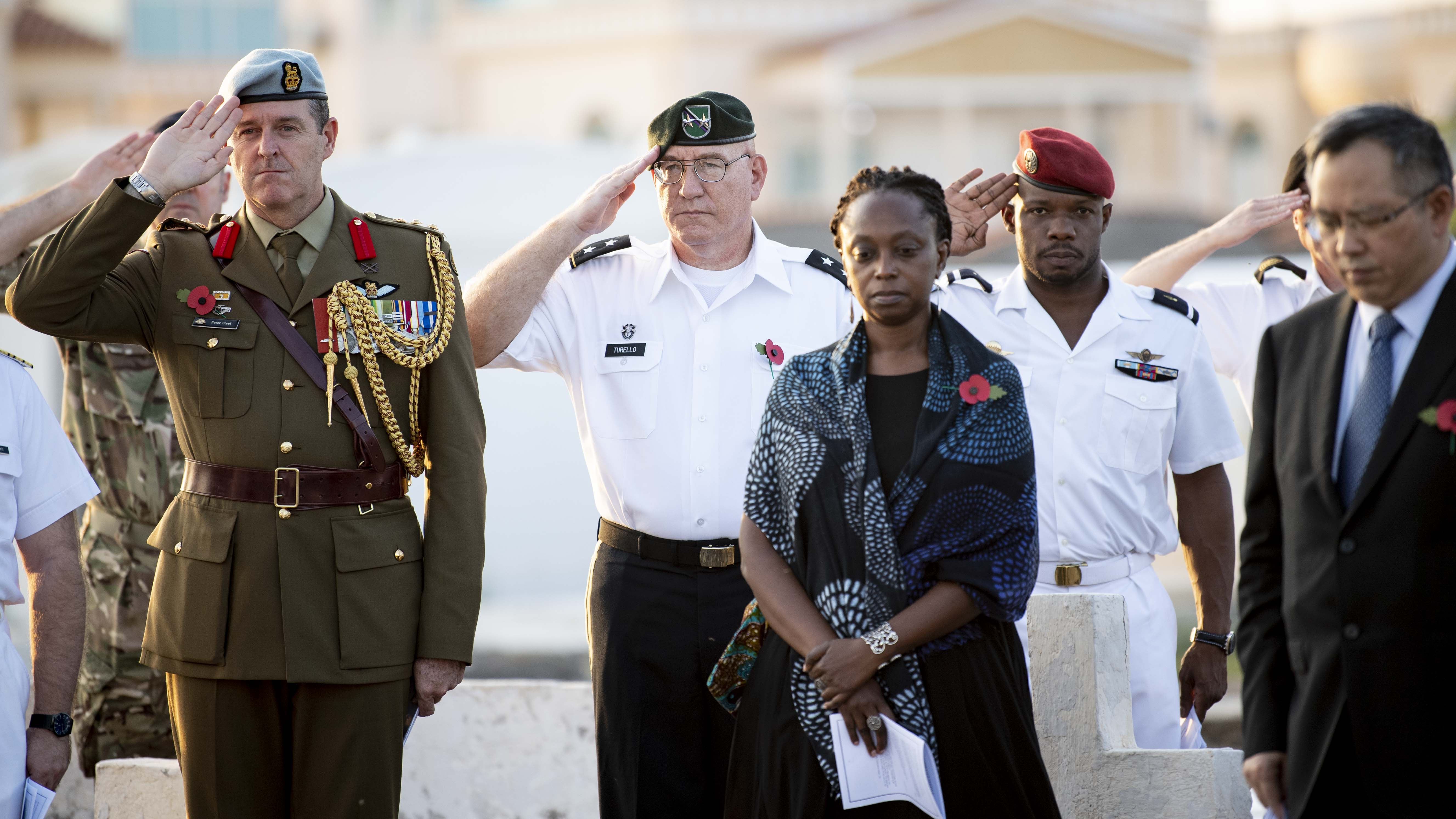 U.S. Army Maj. Gen. Michael Turello, commanding general, Combined Joint Task Force-Horn of Africa, center, salutes during a Remembrance Day service in Djibouti City, Djibouti, Nov. 13, 2019. Traditionally observed on November 11, Remembrance Day commemorates the day hostilities stopped on the western front during World War I. (U.S. Air Force photo by Staff Sgt. J.D. Strong II)
