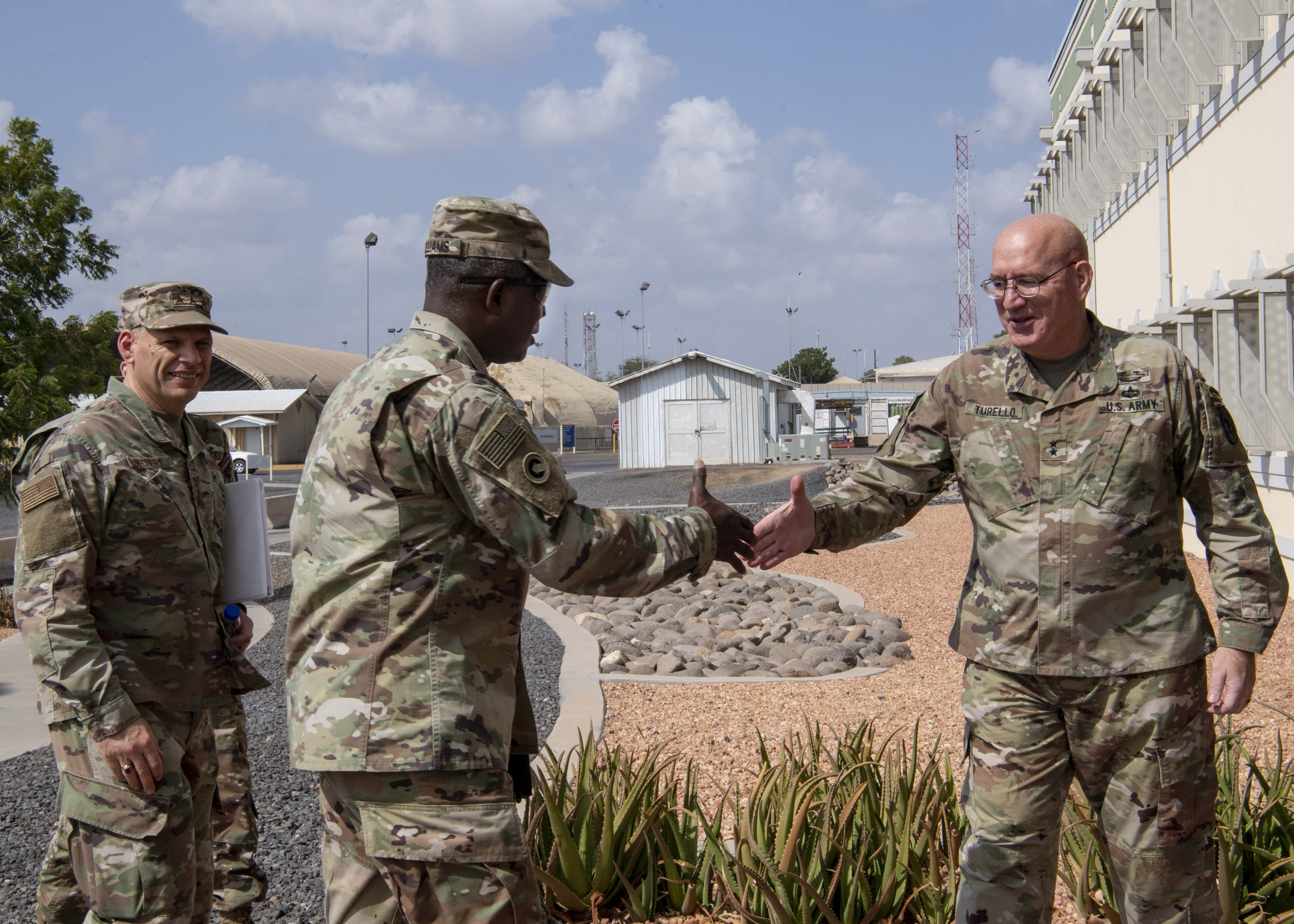 U.S. Army Maj. Gen. Michael Turello, commanding general, Combined Joint Task Force-Horn of Africa (CJTF-HOA) right, greets U.S. Army Lt. Gen. Darrell Williams, director, Defense Logistics Agency at, Camp Lemonnier, Djibouti, Nov. 16, 2019. Williams visited Camp Lemonnier to learn about the CJTF-HOA mission and its contributions to East Africa. (U.S. Air Force photo by Staff Sgt. J.D. Strong II)
