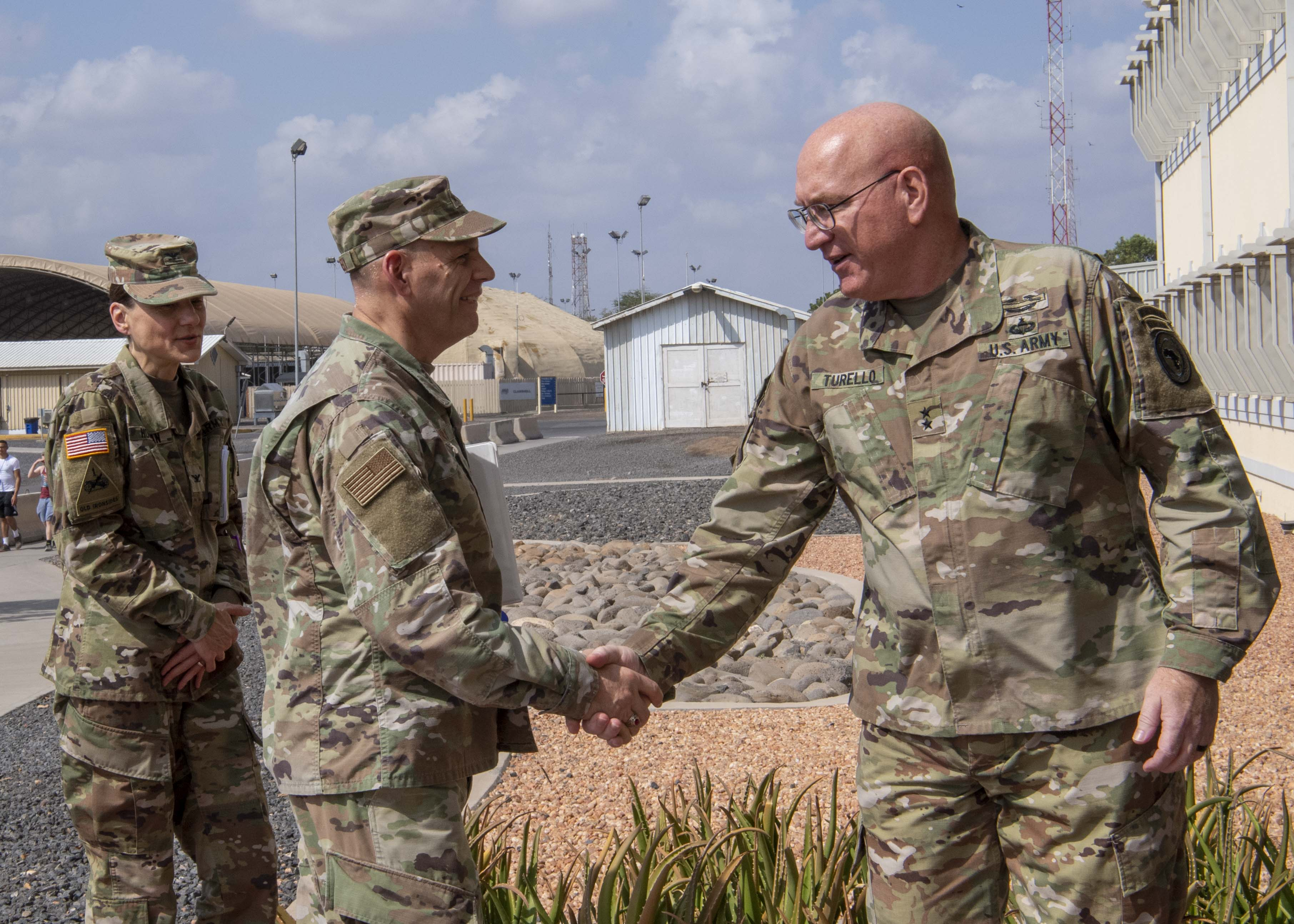 U.S. Army Maj. Gen. Michael Turello, commanding general, Combined Joint Task Force-Horn of Africa (CJTF-HOA) right, greets U.S. Air Force Lt. Gen. James C. Vechery, deputy to the commander for military operations, U.S. Africa Command, at Camp Lemonnier, Djibouti, Nov. 16, 2019. Vechery visited Camp Lemonnier to learn about the CJTF-HOA mission and its contributions to East Africa. (U.S. Air Force photo by Staff Sgt. J.D. Strong II)