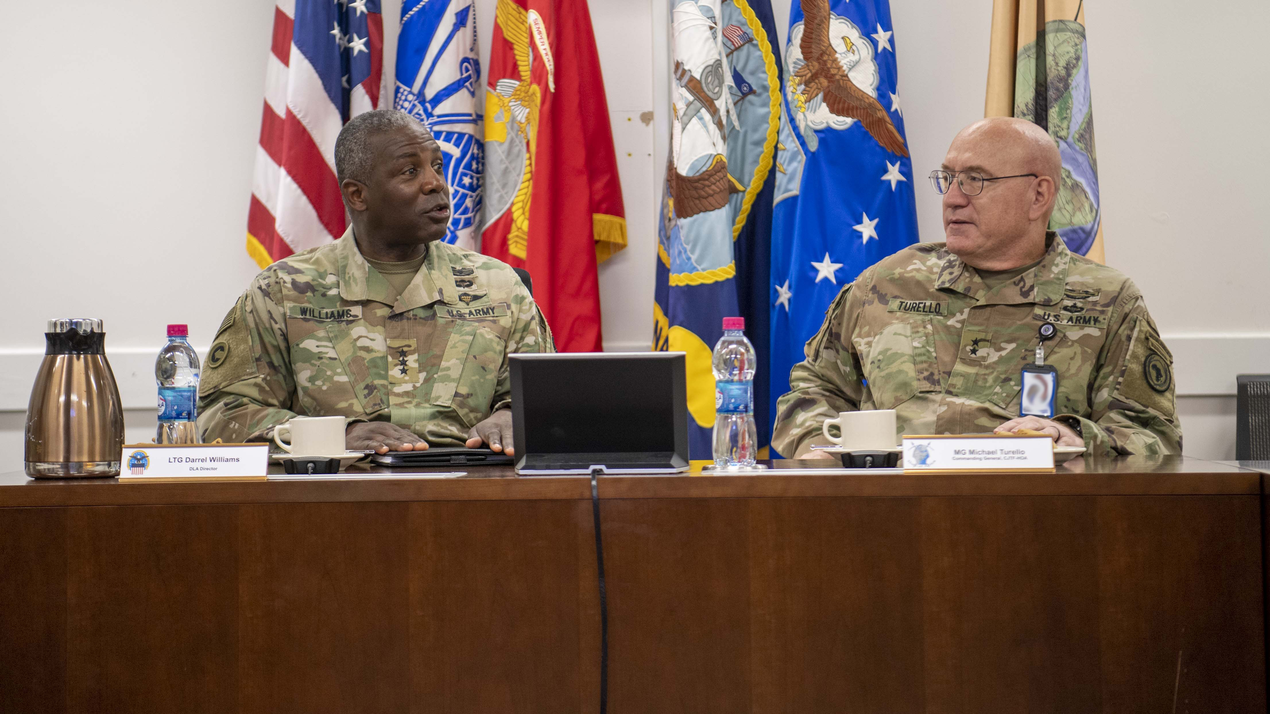 U.S. Army Maj. Gen. Michael Turello, commanding general, Combined Joint Task Force-Horn of Africa (CJTF-HOA) right, speaks with U.S. Army Lt. Gen. Darrell Williams, director, Defense Logistics Agency, at Camp Lemonnier, Djibouti, Nov. 16, 2019. Williams visited Camp Lemonnier to learn about the CJTF-HOA mission and its contributions to East Africa. (U.S. Air Force photo by Staff Sgt. J.D. Strong II)