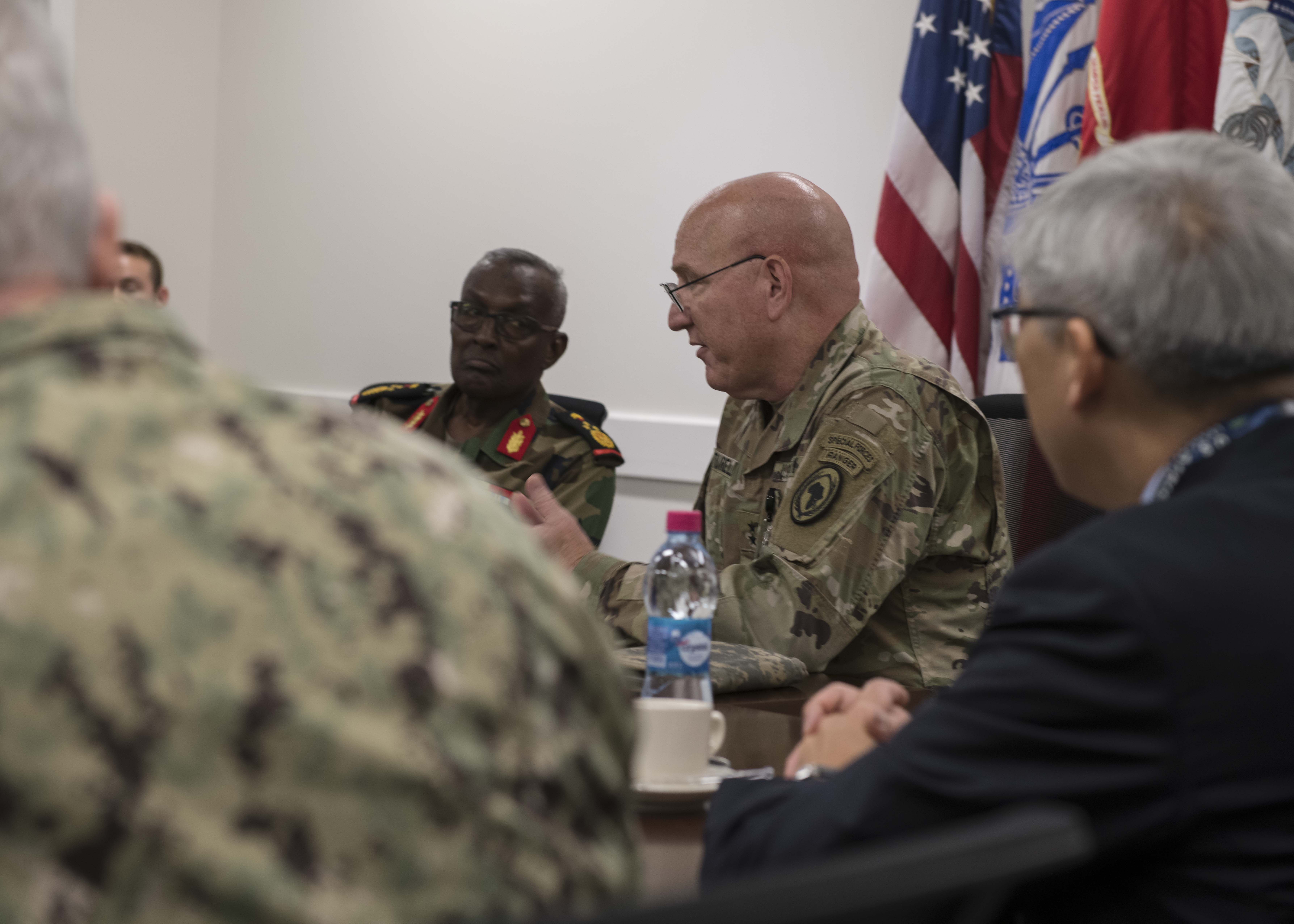 U.S. Army Maj. Gen. Michael D. Turello, commanding general of Combined Joint Task Force-Horn of Africa (CJTF-HOA) meets with Brig. Gen. Ali Mohamed Tahir, headquarters chief of staff of Djibouti Armed Forces (FAD) on Camp Lemonnier, Djibouti, Nov. 14, 2019. Turello and Tahir met and discussed the relationship between CJTF-HOA and the FAD. (U.S. Air Force Photo by Senior Airman Codie Trimble)
