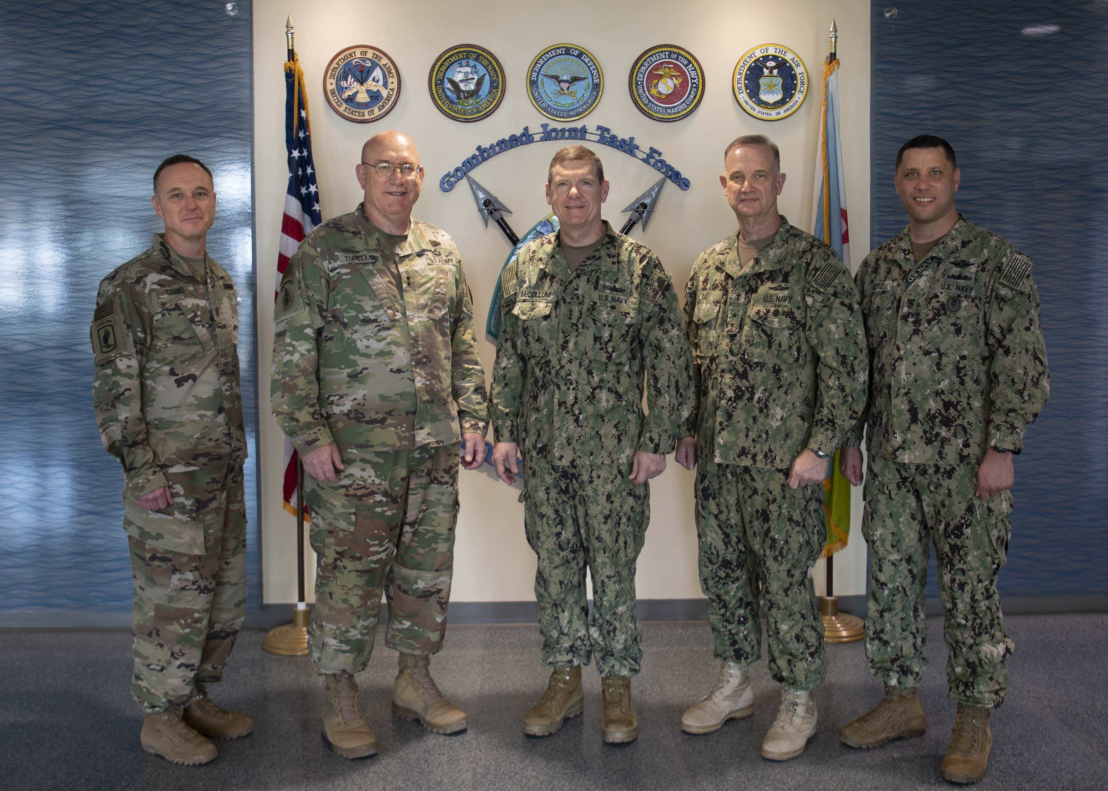 From left, U.S. Army Command Sgt. Maj. Shawn Carns, command senior enlisted leader (CSEL), Combined Joint Task Force-Horn of Africa (CJTF-HOA), U.S. Army Maj. Gen. Michael Turello, commanding general, CJTF-HOA, U.S. Navy Vice Adm. Luke McCollum, commander, Navy Reserve Force, chief, Navy Reserve, U.S. Navy Rear Adm. Endel Lee, deputy chief of chaplains, Reserve Matters, and U.S. Navy Master Chief Christopher Kotz, force master chief, Navy Reserve, pose for a group photo at Camp Lemonnier, Djibouti, Nov. 29, 2019. McCollum visited Camp Lemonnier to meet with deployed Navy Reserve sailors and other service members. (U.S. Air Force photo by Staff Sgt. J.D. Strong II)