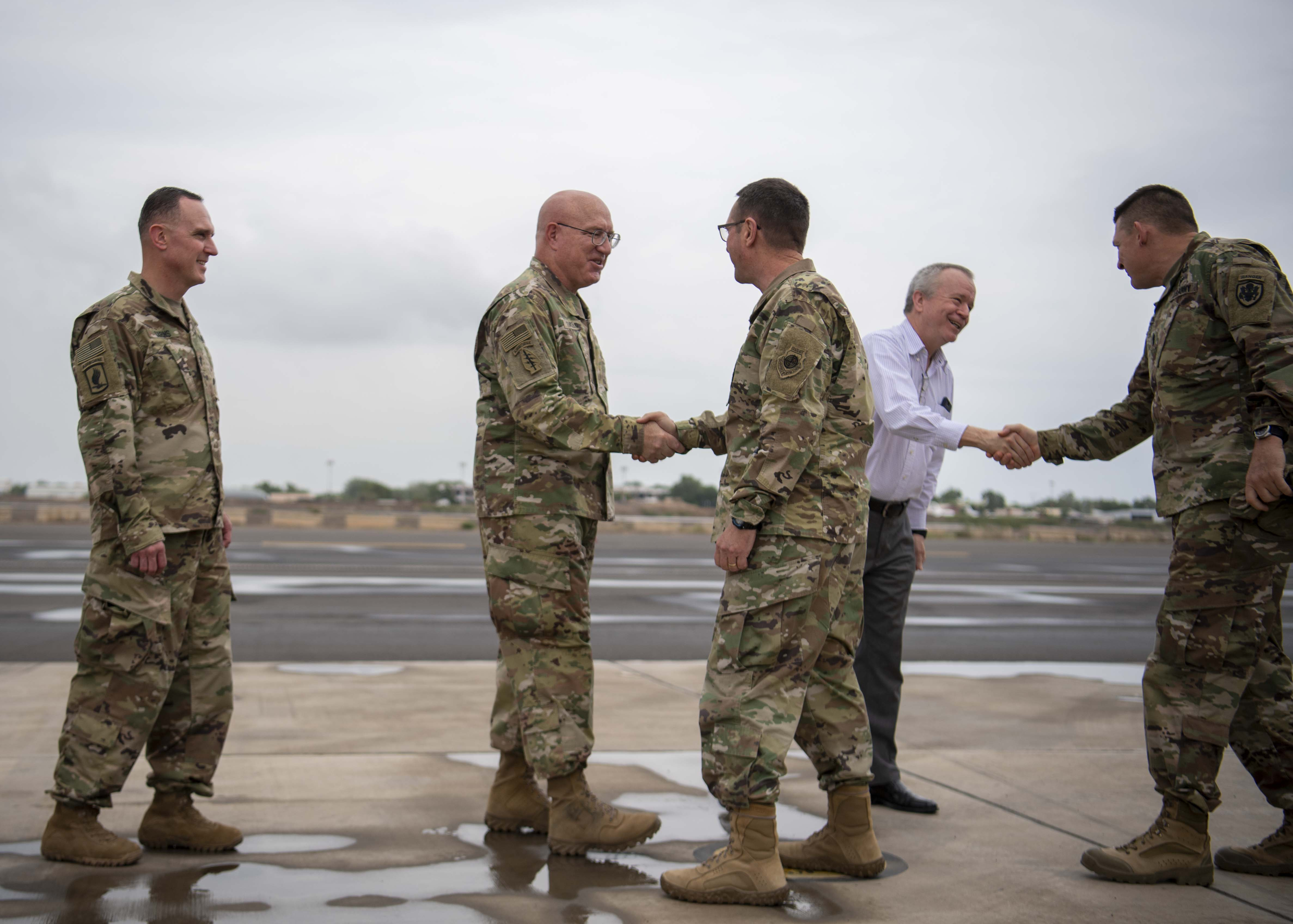 U.S. Army Maj. Gen. Michael Turello, commanding general, Combined Joint Task Force-Horn of Africa (CJTF-HOA), (center-left), greets U.S. Air Force Gen. Joseph Lengyel, chief, National Guard Bureau, (center-right), at Camp Lemonnier, Djibouti, Nov. 28, 2019. Lengyel visited Camp Lemonnier to meet with deployed National Guardsmen and other service members. (U.S. Air Force photo by Staff Sgt. J.D. Strong II)