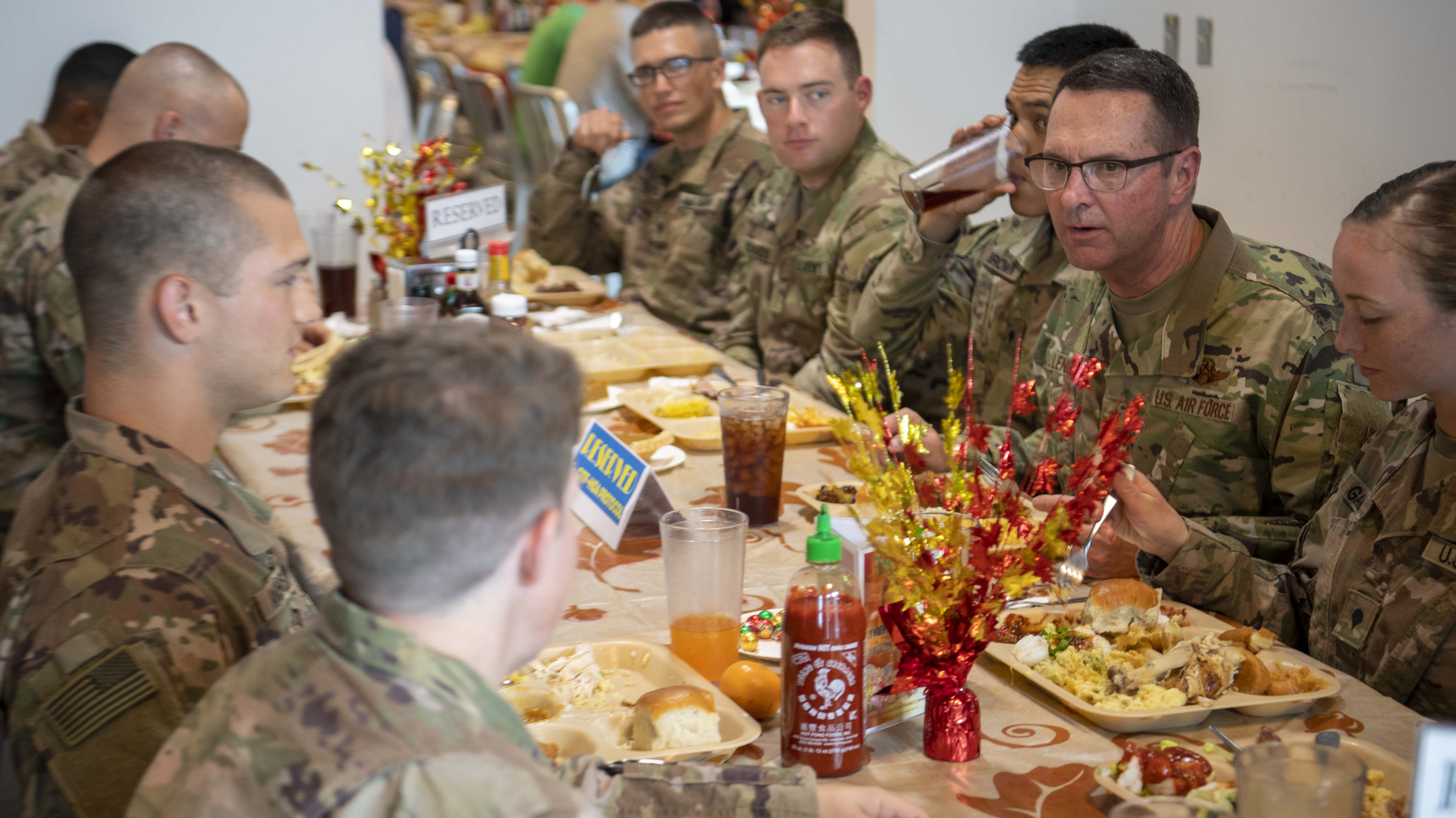 U.S. Air Force Gen. Joseph Lengyel, chief, National Guard Bureau, (right), eats Thanksgiving dinner with U.S. service members at Camp Lemonnier, Djibouti, Nov. 28, 2019. Lengyel visited Camp Lemonnier to meet with deployed National Guardsmen and other service members. (U.S. Air Force photo by Staff Sgt. J.D. Strong II)