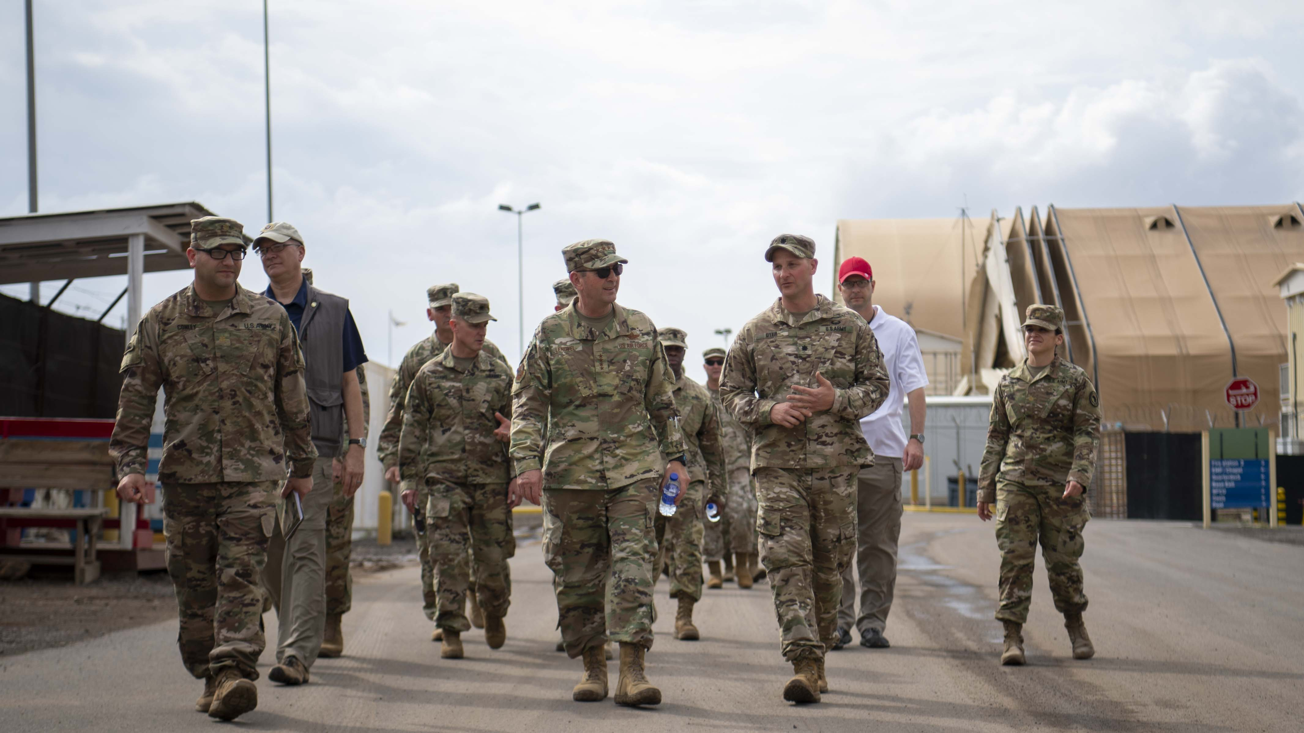 U.S. Air Force Gen. Joseph Lengyel, chief, National Guard Bureau, speaks to U.S. Army Lt. Col. Paul Dyer, commander, Task Force-Guardian, assigned to Combined Joint Task Force-Horn of Africa security forces at Camp Lemonnier, Djibouti, Nov. 28, 2019. Lengyel visited Camp Lemonnier to meet with deployed National Guardsmen and other service members. (U.S. Air Force photo by Staff Sgt. J.D. Strong II)