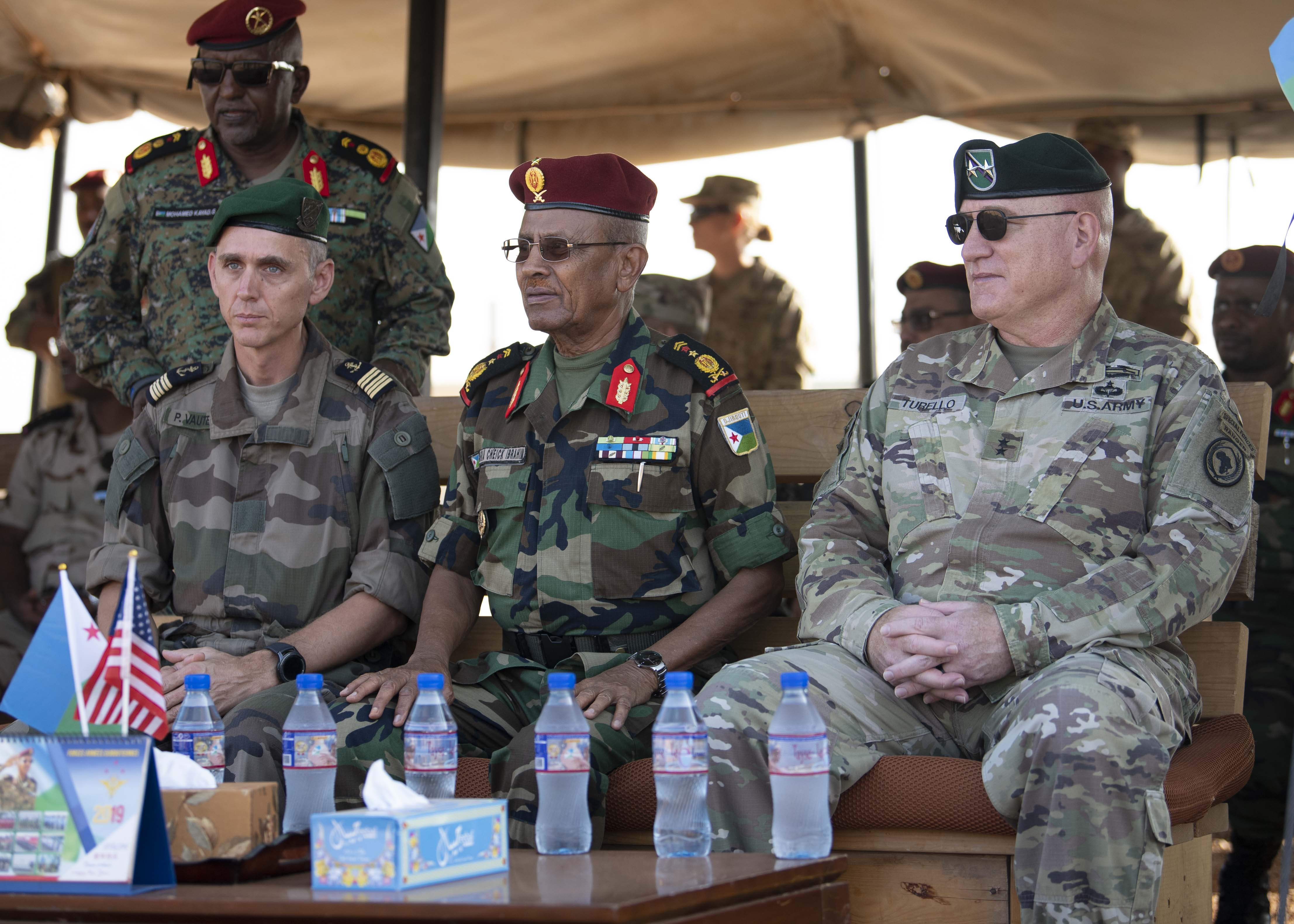 U.S. Army Maj. Gen. Michael D. Turello, commanding general of Combined Joint Task Force-Horn of Africa (CJTF-HOA) (right), Djiboutian Lt. Gen. Zakaria Cheikh Ibrahim, chief of staff of the Djibouti Armed Forces (center) and French Navy Capt. Phillippe, deputy commander French Forces of Djibouti, sit during the Rapid Intervention Battalion (RIB) change of command, in Djibouti, Oct. 31, 2019. Djiboutian Maj. Mohamed Assowen assumed command of the RIB from Djiboutian Capt. Omar Ali Hassan. (U.S. Air Force photo by Staff Sgt. J.D. Strong II)