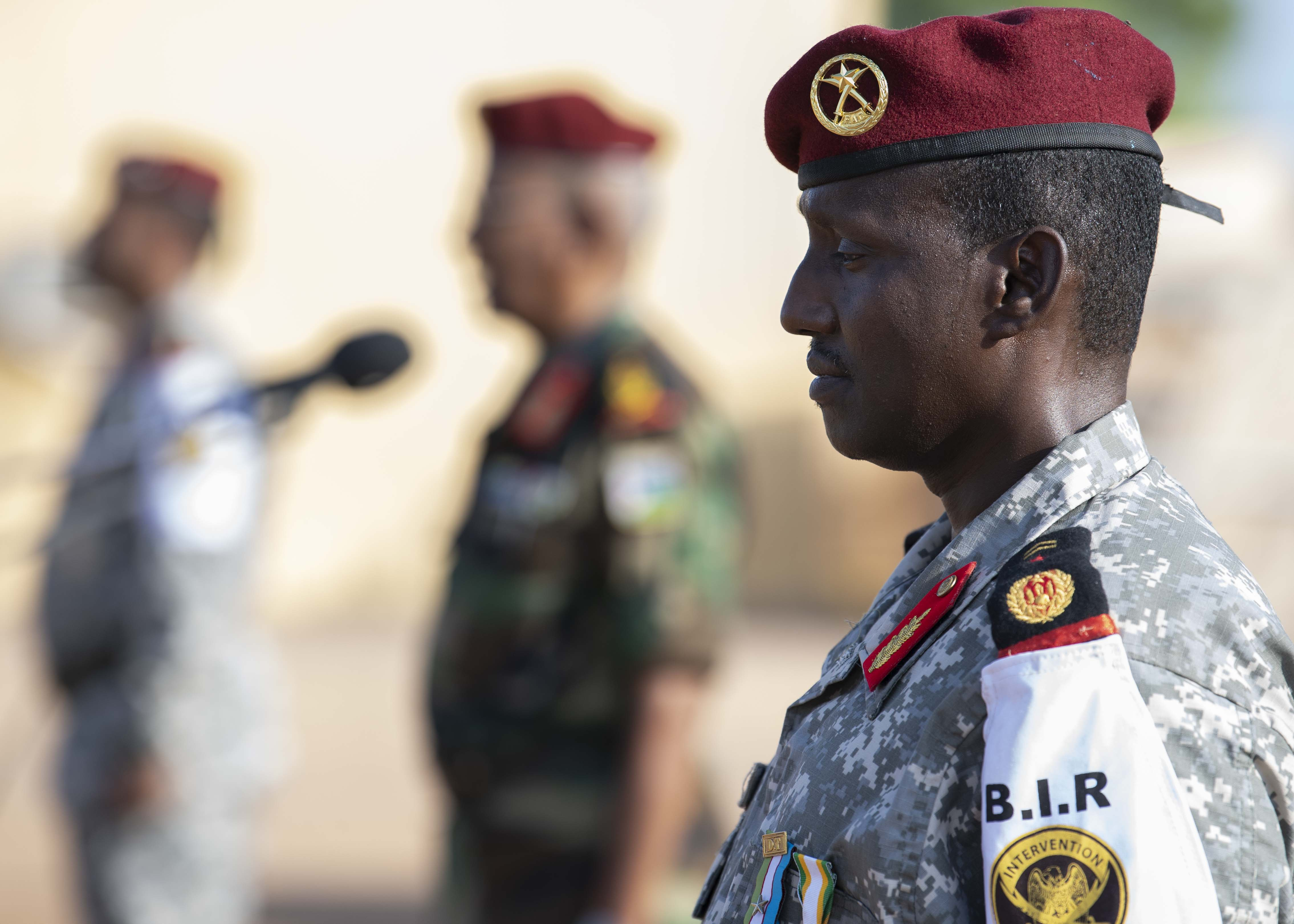 Djiboutian Maj. Mohamed Assowen, commander of the Rapid Intervention Battalion, stands at attention during the Rapid Intervention Battalion (RIB) change of command, in Djibouti, Oct. 31, 2019. Assowen assumed command of the RIB from Djiboutian Capt. Omar Ali Hassan. (U.S. Air Force photo by Staff Sgt. J.D. Strong II)
