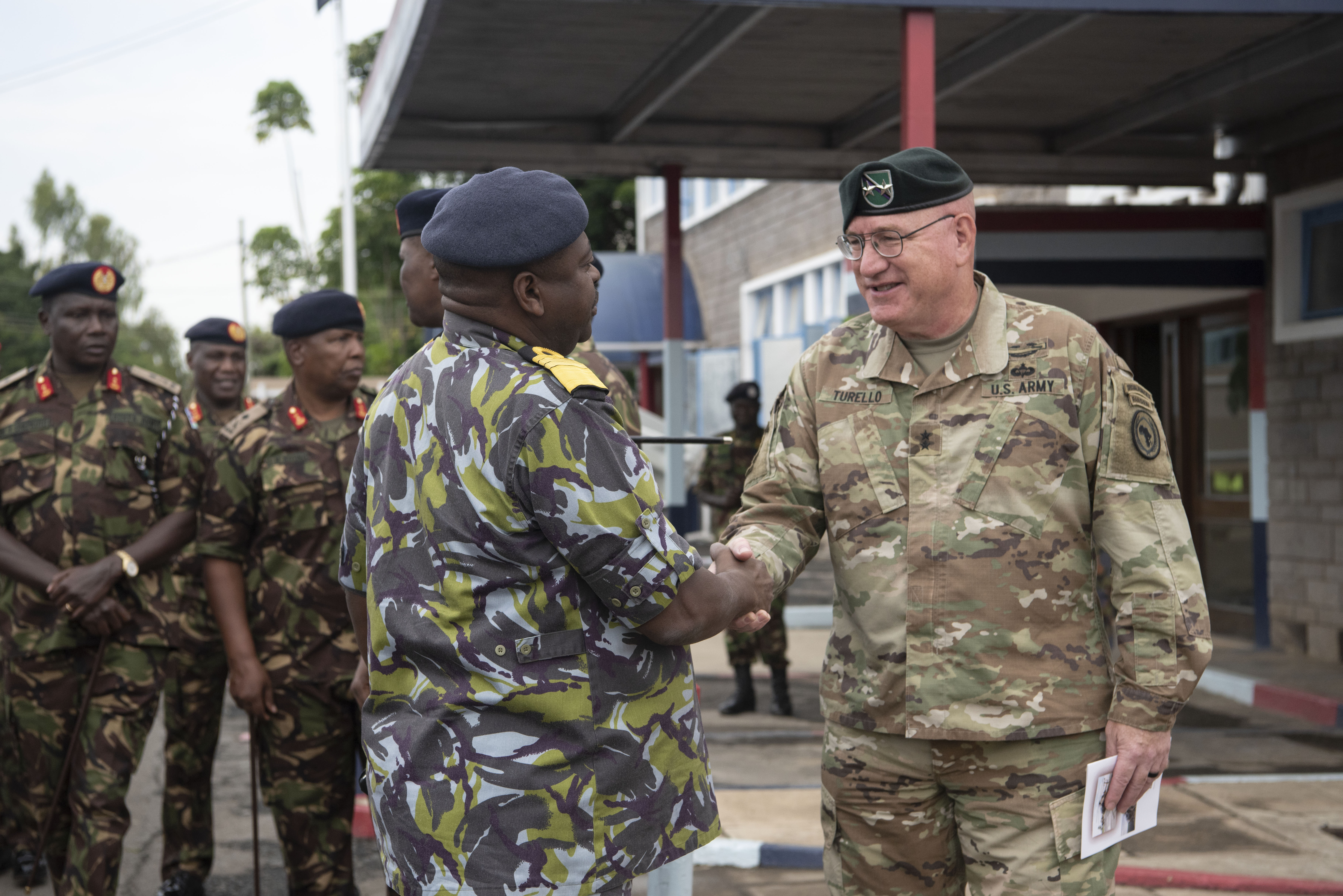 U.S. Army Maj. Gen. Michael D. Turello, right, commanding general of Combined Joint Task Force-Horn of Africa, greets Gen. Samson Mwathethe, chief of Kenyan Defense Forces (KDF), during a Helicopter Handover Ceremony at Embakasi Barracks, Kenya, Jan. 23, 2020. During the ceremony, six MD-530F Cayuse Warrior helicopters were delivered to the KDF in a symbolic handover. Six more MD-530F helicopters will be delivered to the KDF in the near future. (U.S. Air Force photo by Tech. Sgt. Ashley Nicole Taylor)
