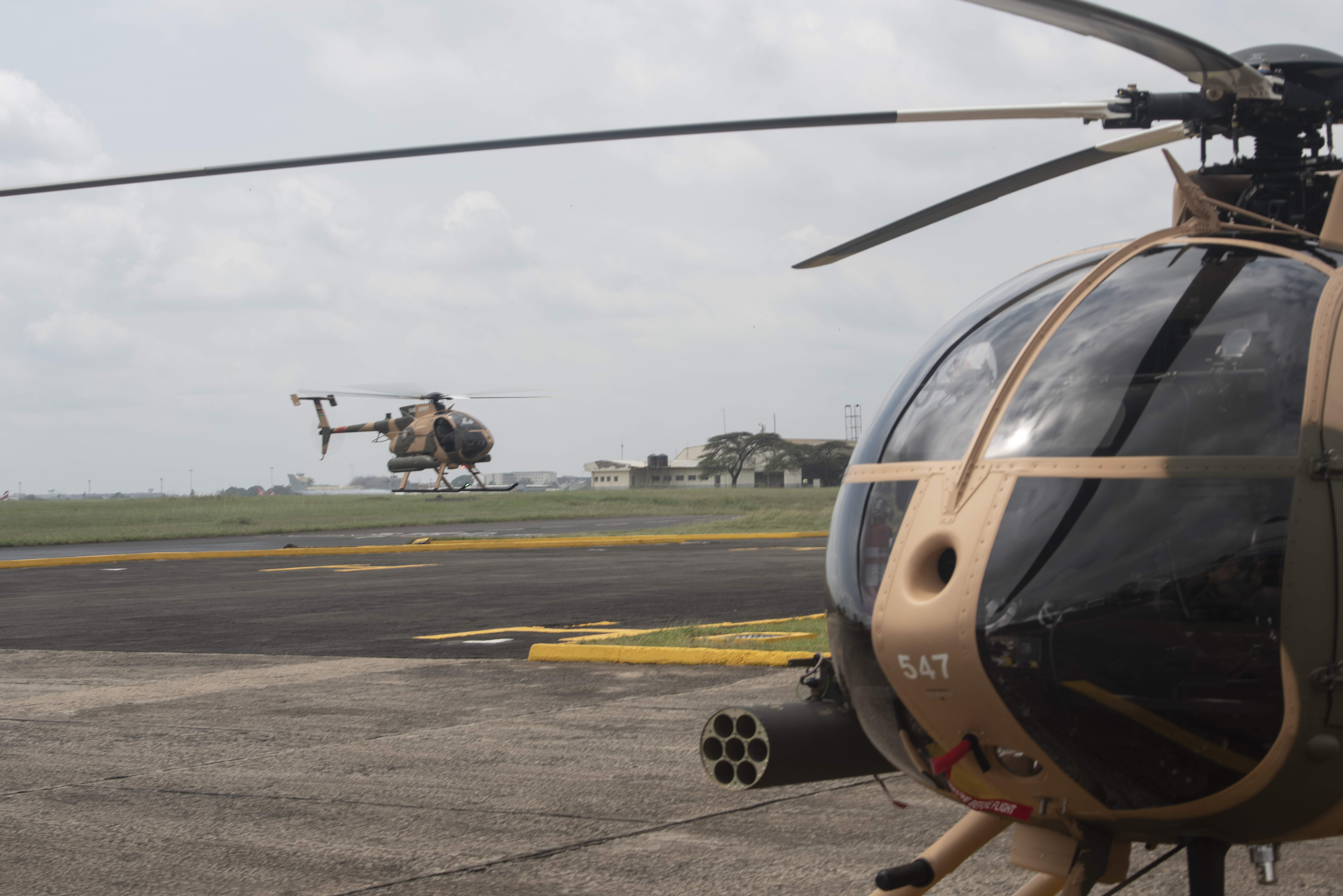 An MD-530F Cayuse Warrior Helicopter prepares to land after a flyover during a Helicopter exchange ceremony, at Embakasi Barracks, Kenya, Jan. 23, 2020. During the ceremony, six MD-530F Cayuse Warrior helicopters were delivered to the KDF in a symbolic handover. Six more MD-530F helicopters will be delivered to the KDF in the near future. (U.S. Air Force photo by Tech. Sgt. Ashley Nicole Taylor)