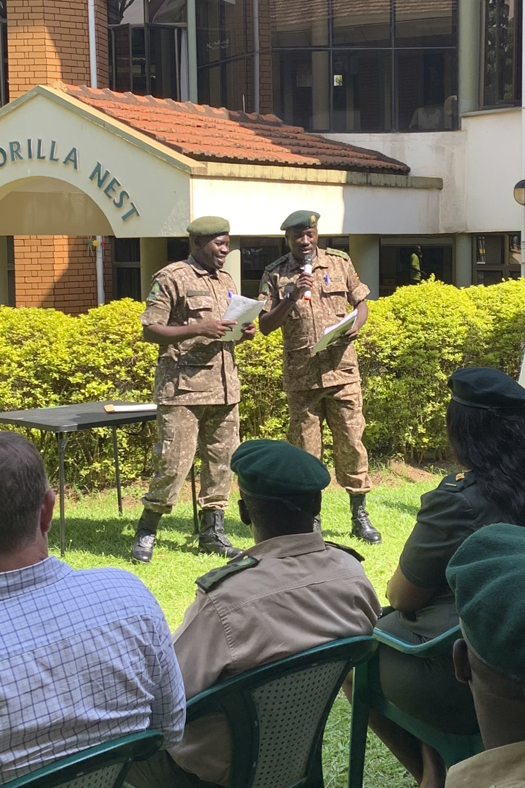 Wardens from the Uganda Wildlife Authority (UWA) lead a discussion about the Combined Joint Task Force-Horn of Africa 411th Civil Affairs (CA) Pilot Senior Leader Program (PSLP) during the graduation ceremony at Kampala, Uganda, March 6, 2020. PSLP was a week-long course to familiarize wardens with the course material 100 of their junior rangers learned as a part of the recurring UWA Junior Leadership Program taught by CA and a manifestation of the ongoing partnership between the United States and Uganda. (U.S. Air Force photo by Senior Airman Gage Daniel)