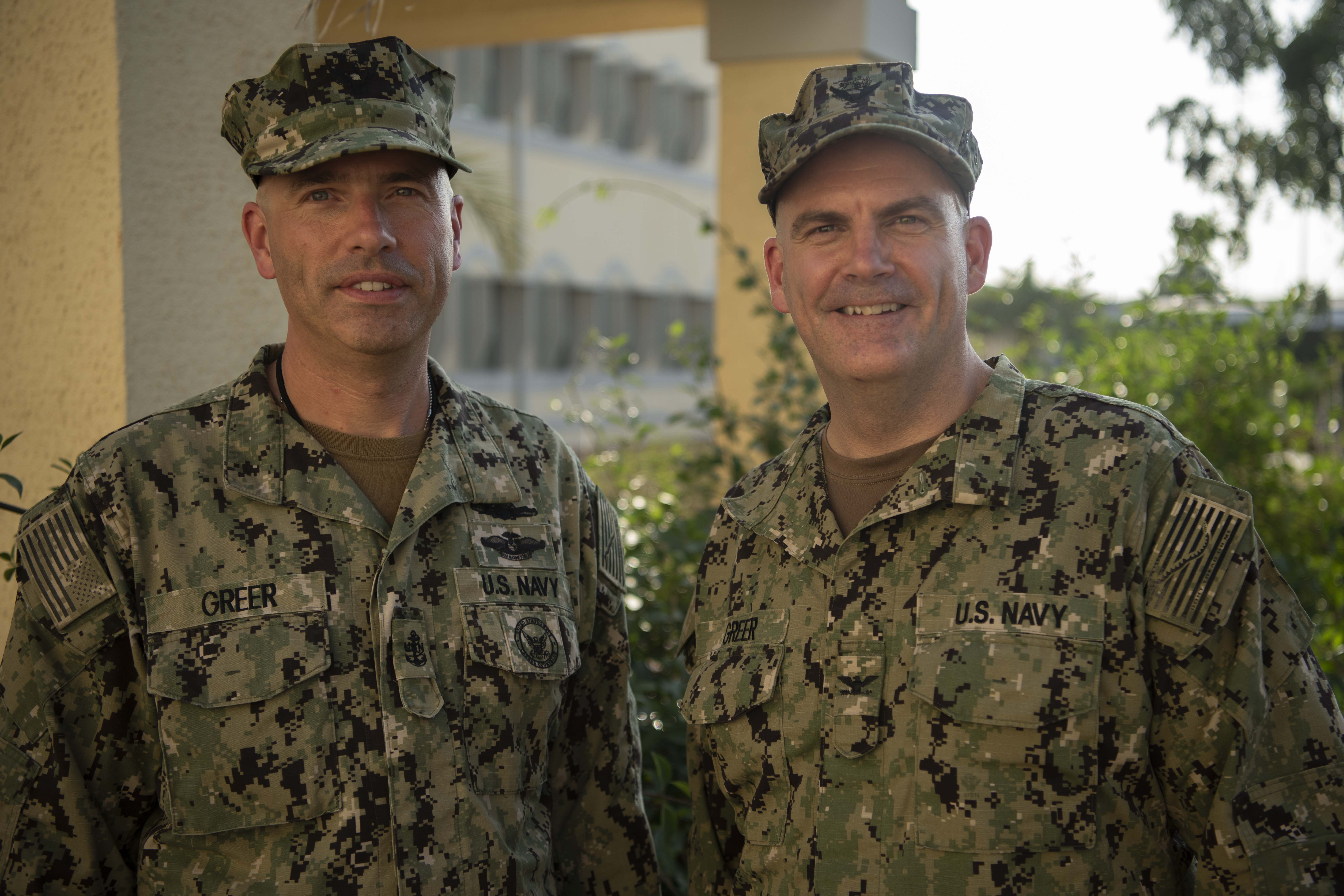 U.S. Navy Chief Hospital Corpsman Tim Greer, left, medical department head for Coastal Riverine Squadron-1 Forward, meets with his brother, Capt. Christopher Greer, staff judge advocate, Combined Joint Task Force-Horn of Africa, at Camp Lemonnier, Djibouti, 11 Feb. 2020. The Greer brothers are from Wilmington, Delaware, and were deployed with each other for about eight months. (U.S. Air Force photo by Master Sgt. Brok McCarthy)