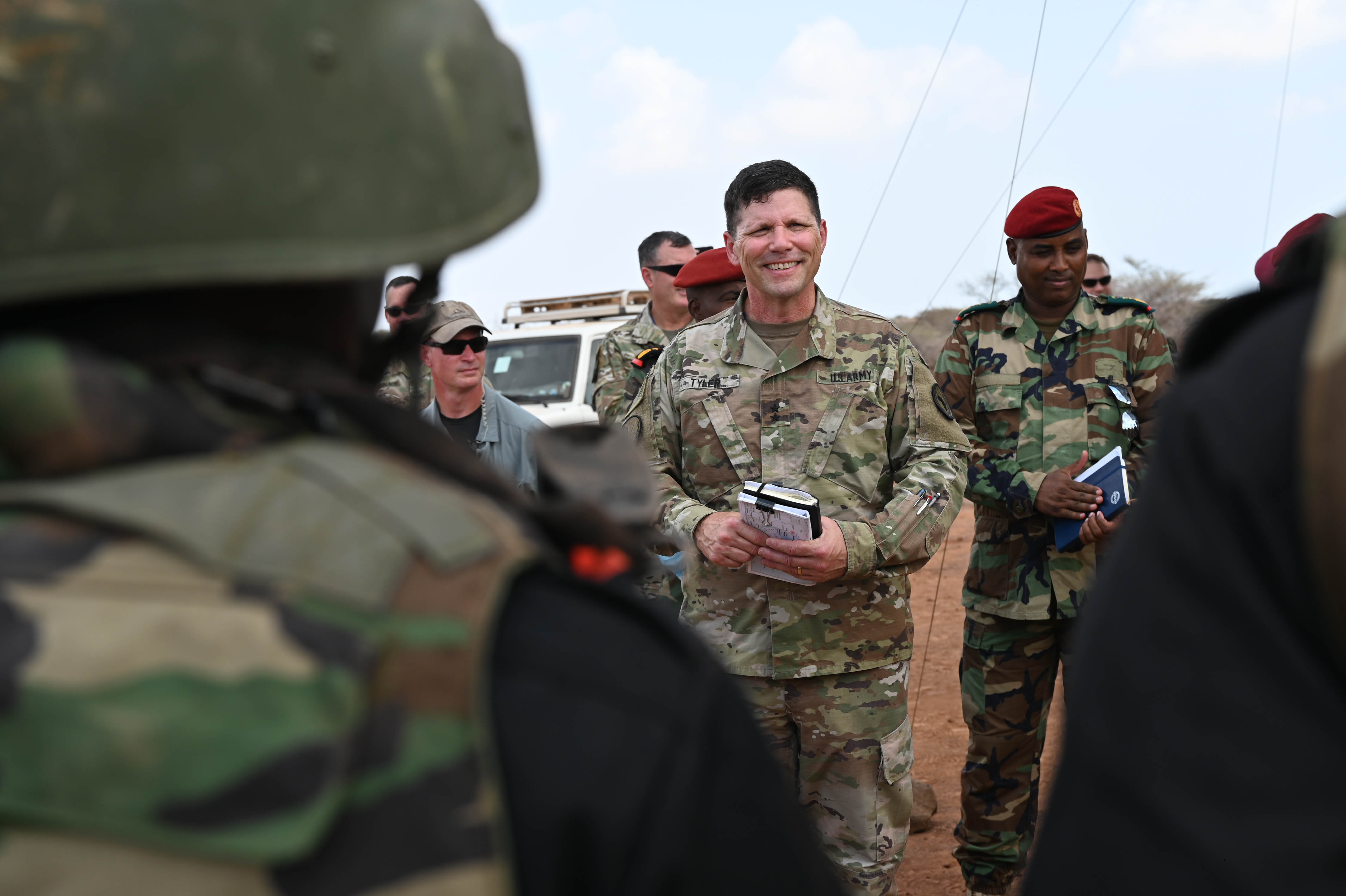 U.S. Army Major General Lapthe C. Flora, commanding general of Combined Joint Task Force - Horn of Africa (CJTF-HOA), chats with U.S. Ambassador to Somalia Donald Y. Yamamoto, and Acting Prime Minister of Somalia Mahdi Mohamed Guled, during reception following a change of command ceremony for the European Union Training Mission - Somalia (EUTM-S) in Mogadishu, Somalia, Aug. 9, 2020. (U.S. Air Force photo by Senior Airman Kristen A. Heller)