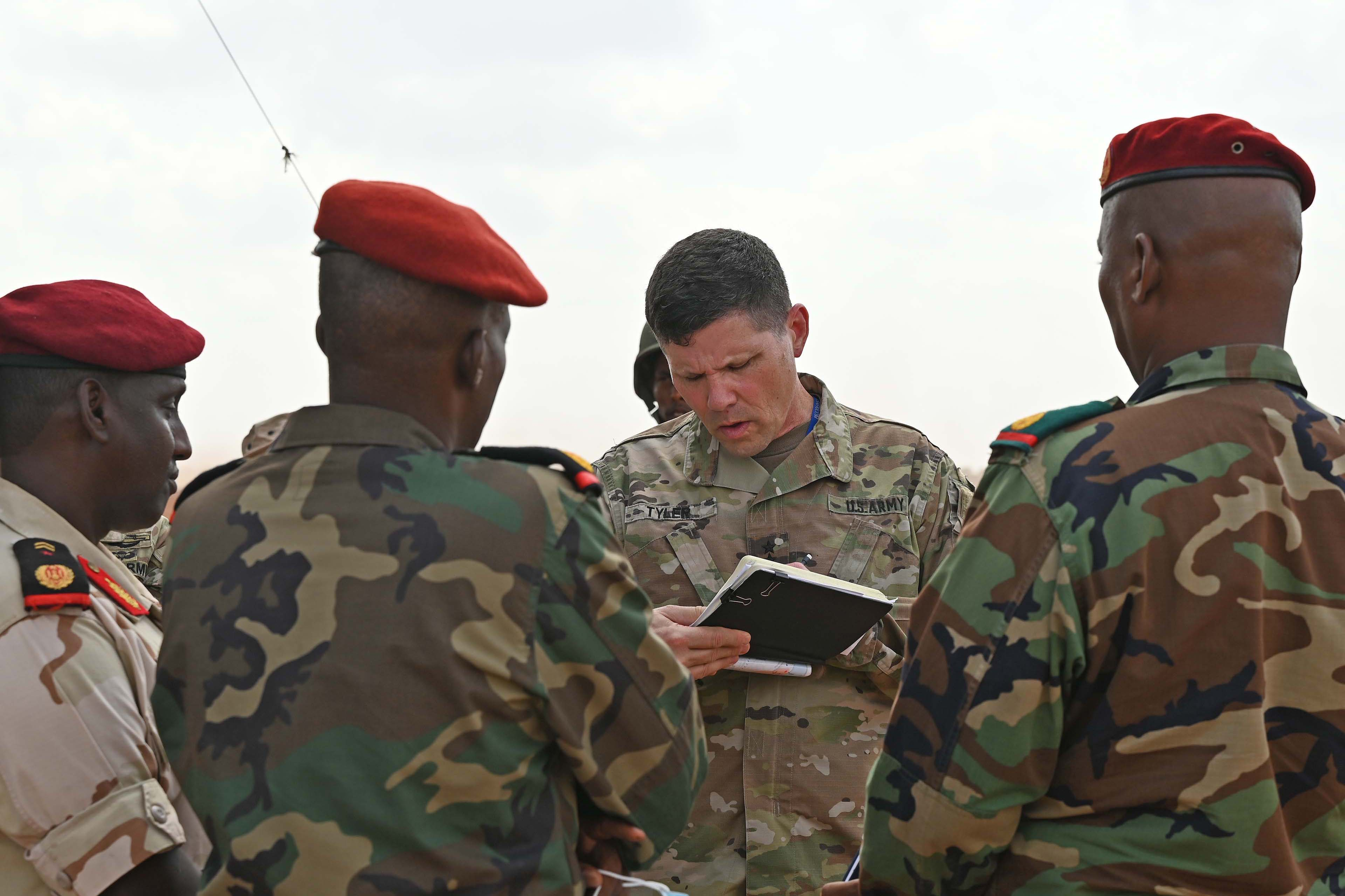 U.S. Army Major General Lapthe C. Flora, commanding general of Combined Joint Task Force - Horn of Africa (CJTF-HOA), talks to Italian Army Brigadier General Fabiano Zinzone, European Union Training Mission - Somalia (EUTM-S) mission force commander, following a change of command ceremony in Mogadishu, Somalia, Aug. 9, 2020. (U.S. Air Force photo by Senior Airman Kristen A. Heller)